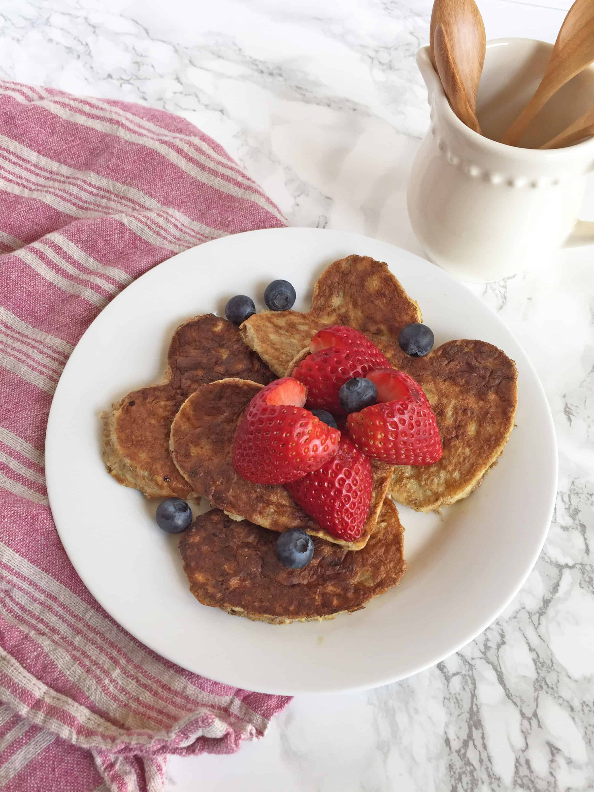 3 ingredient pancakes with strawberries and blueberries.