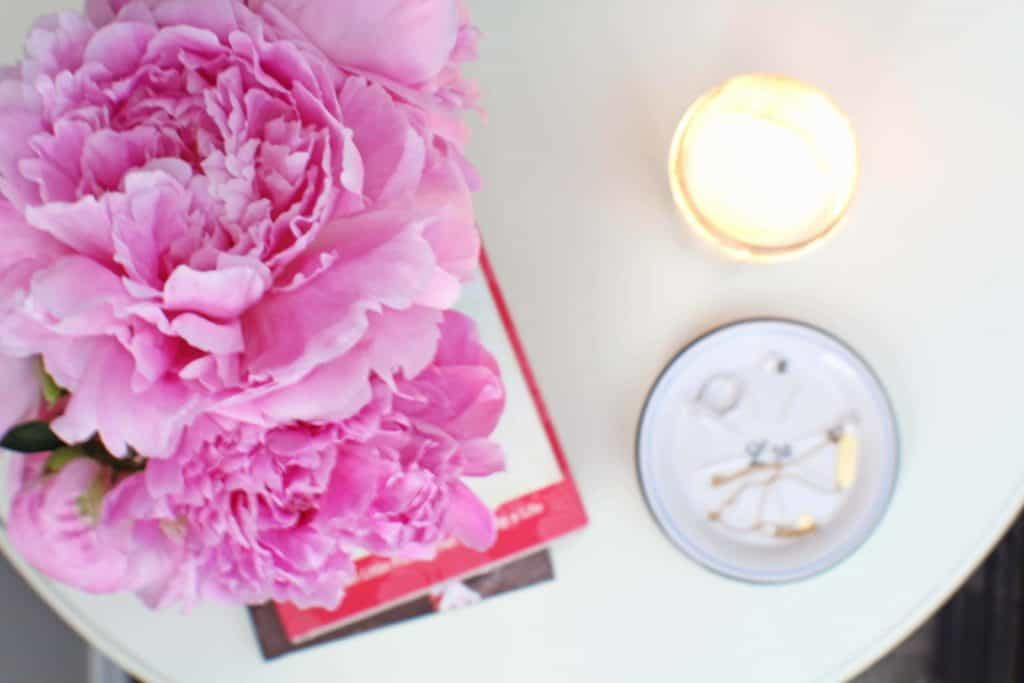 pink peonies on a pottery barn white bedside table