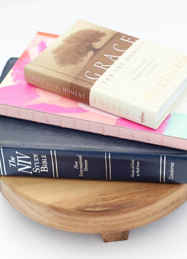 max lucado grace for the moment, niv study bible, hearth and hand footed wood display stand