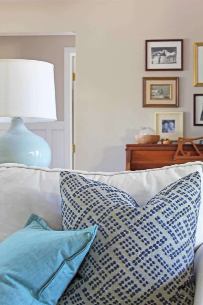 blue and aqua pillows on pottery barn couch