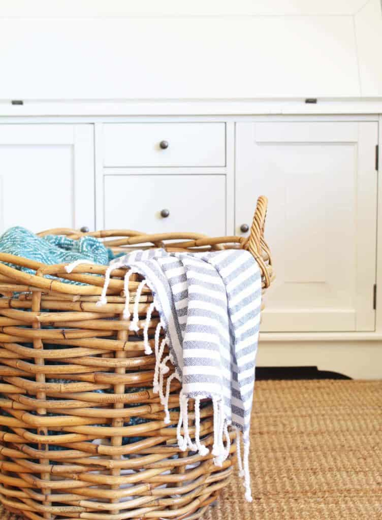 large wicker basket with blankets