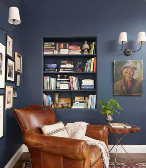 Leather reading chair in room with navy blue walls