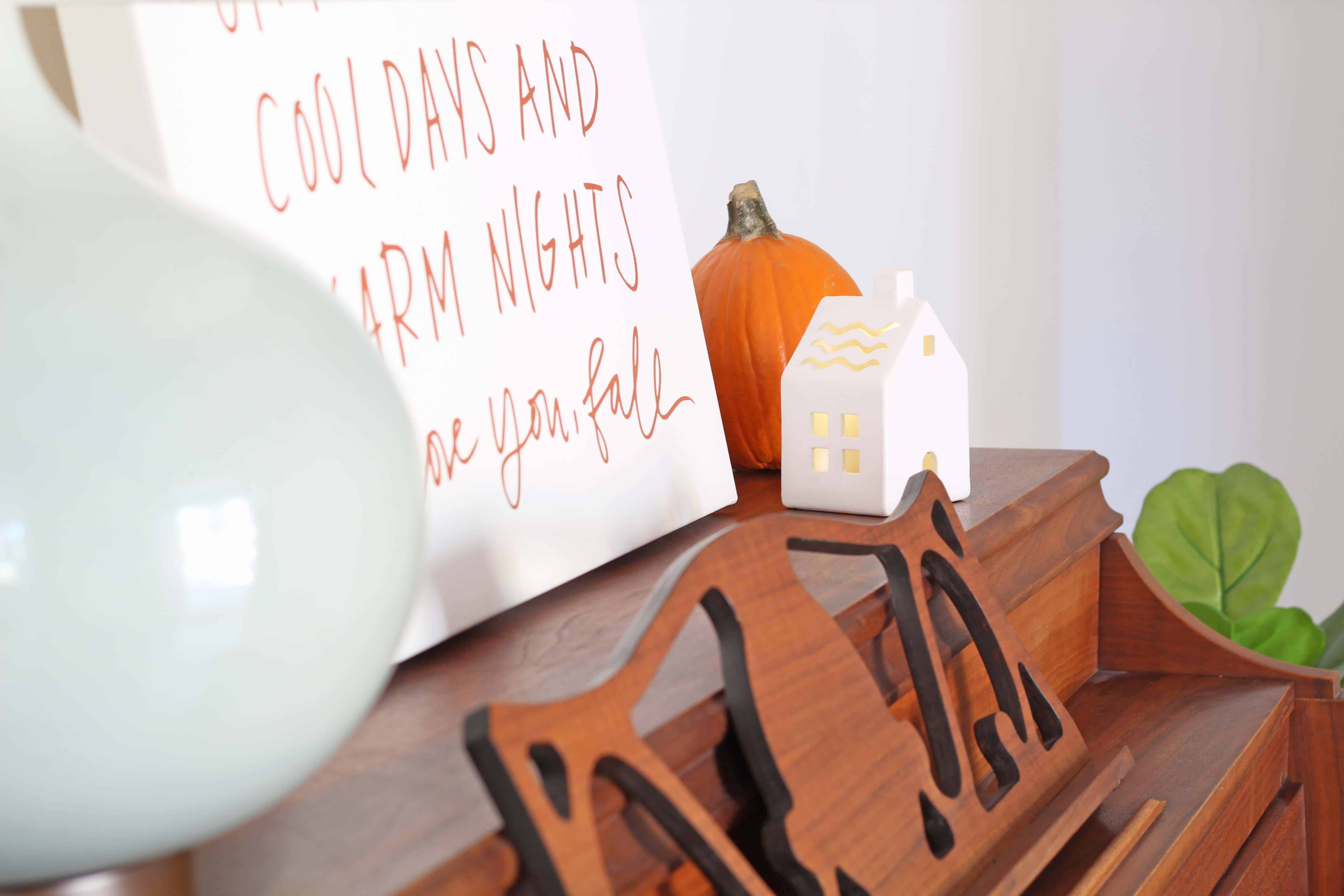 Fall entryway with lindsay letters word art and ceramic village house