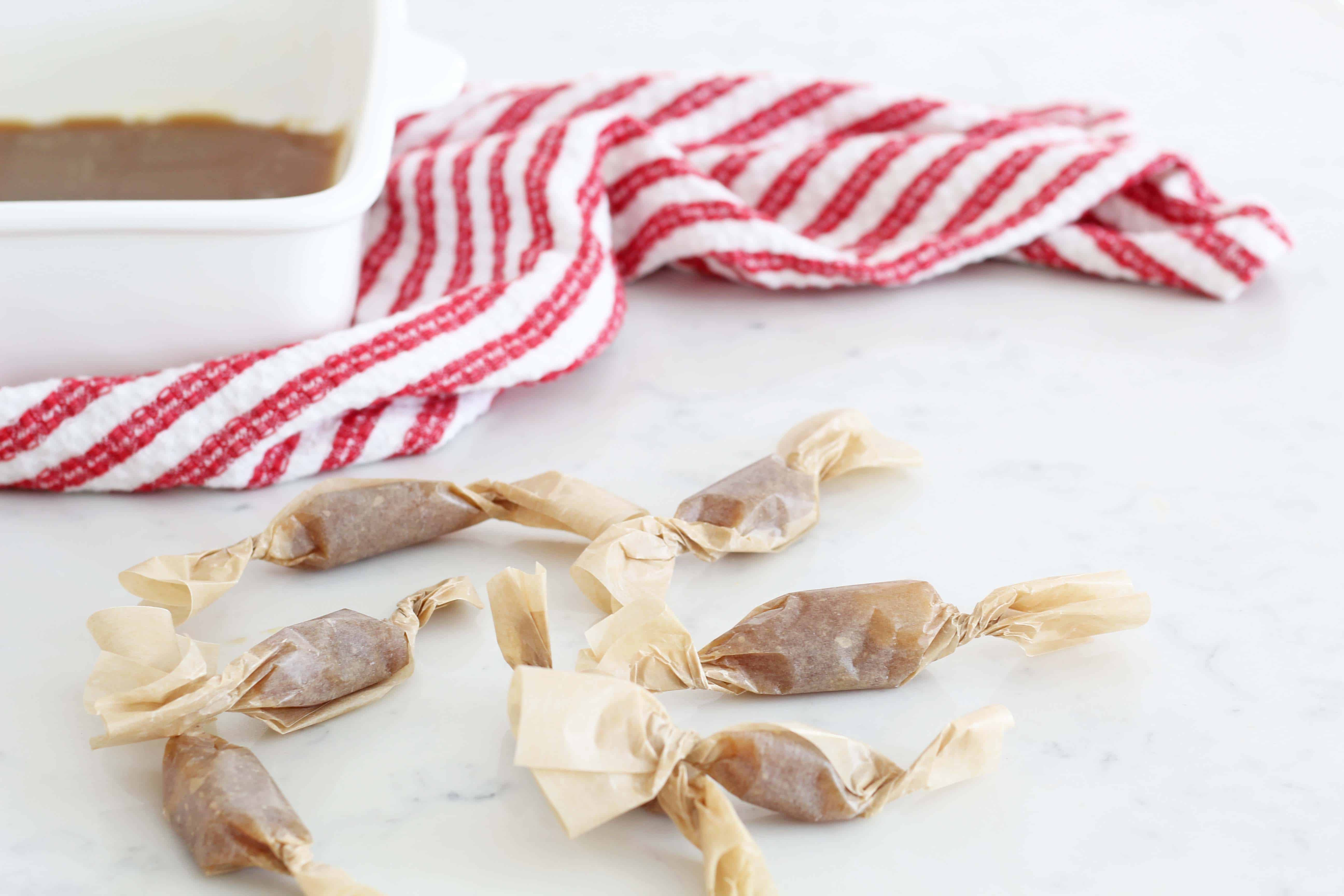 homemade caramels in brown parchment paper