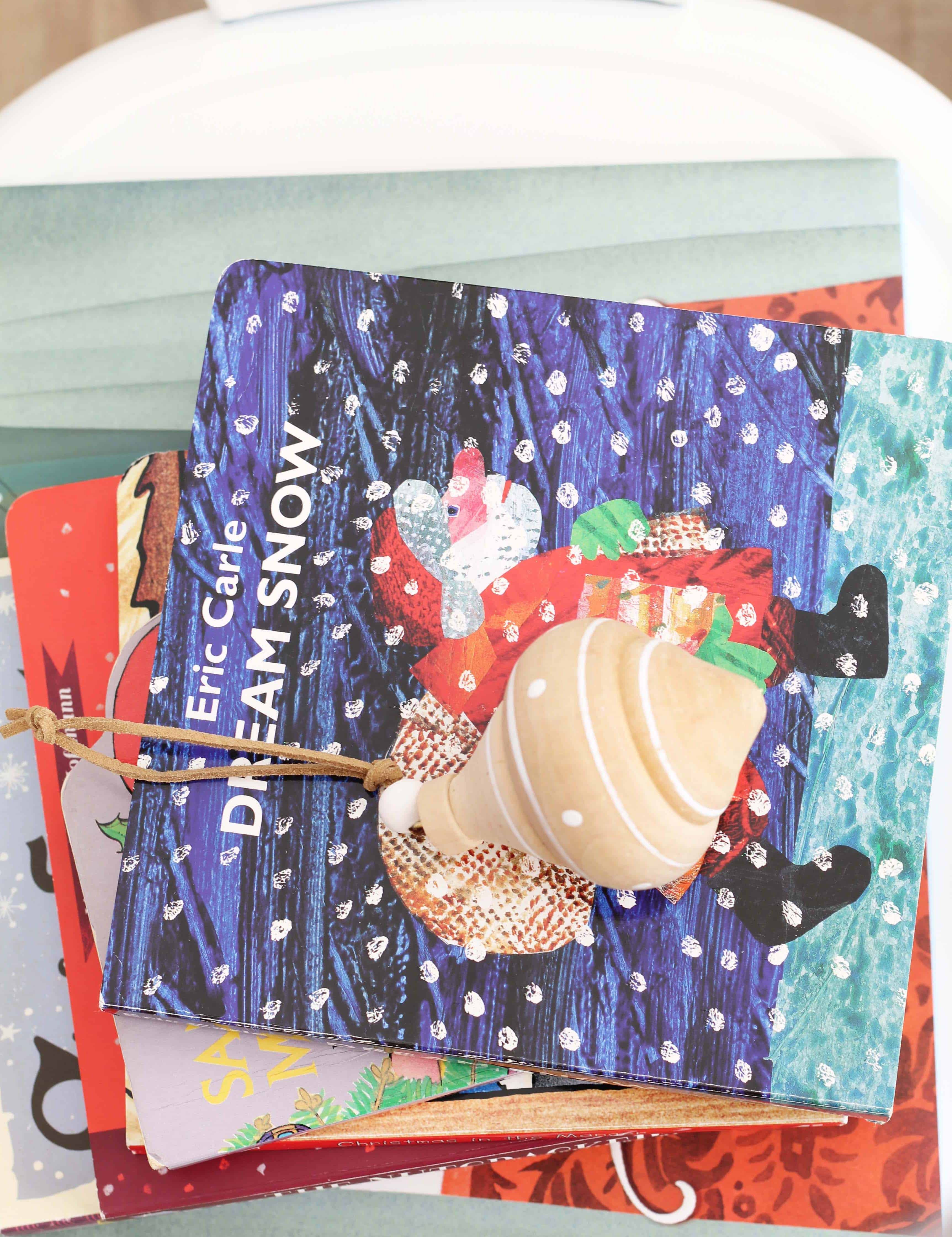 stack of children's christmas books with ornament