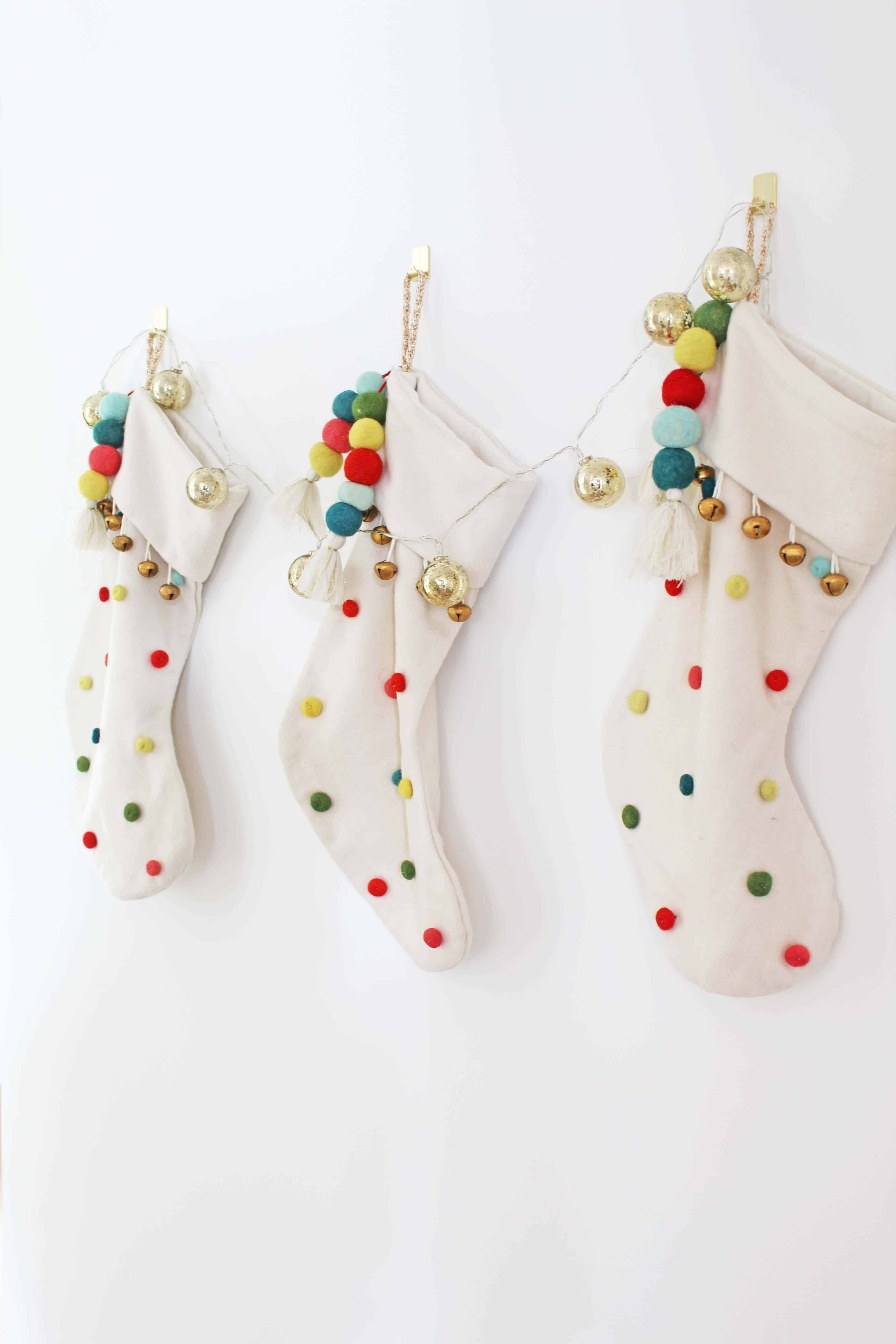 christmas stockings with pom poms and bells