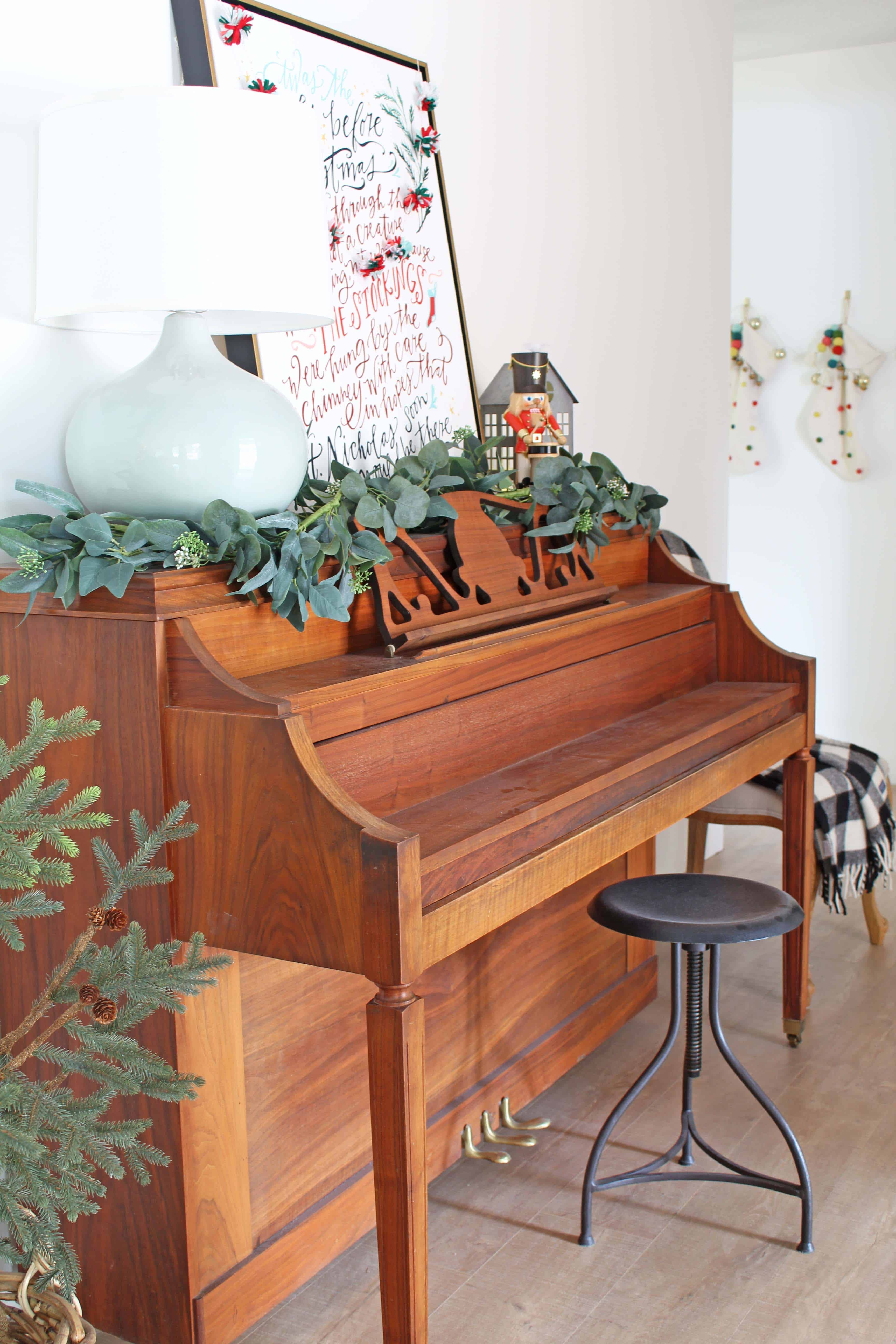 christmas piano with nutcracker and village house