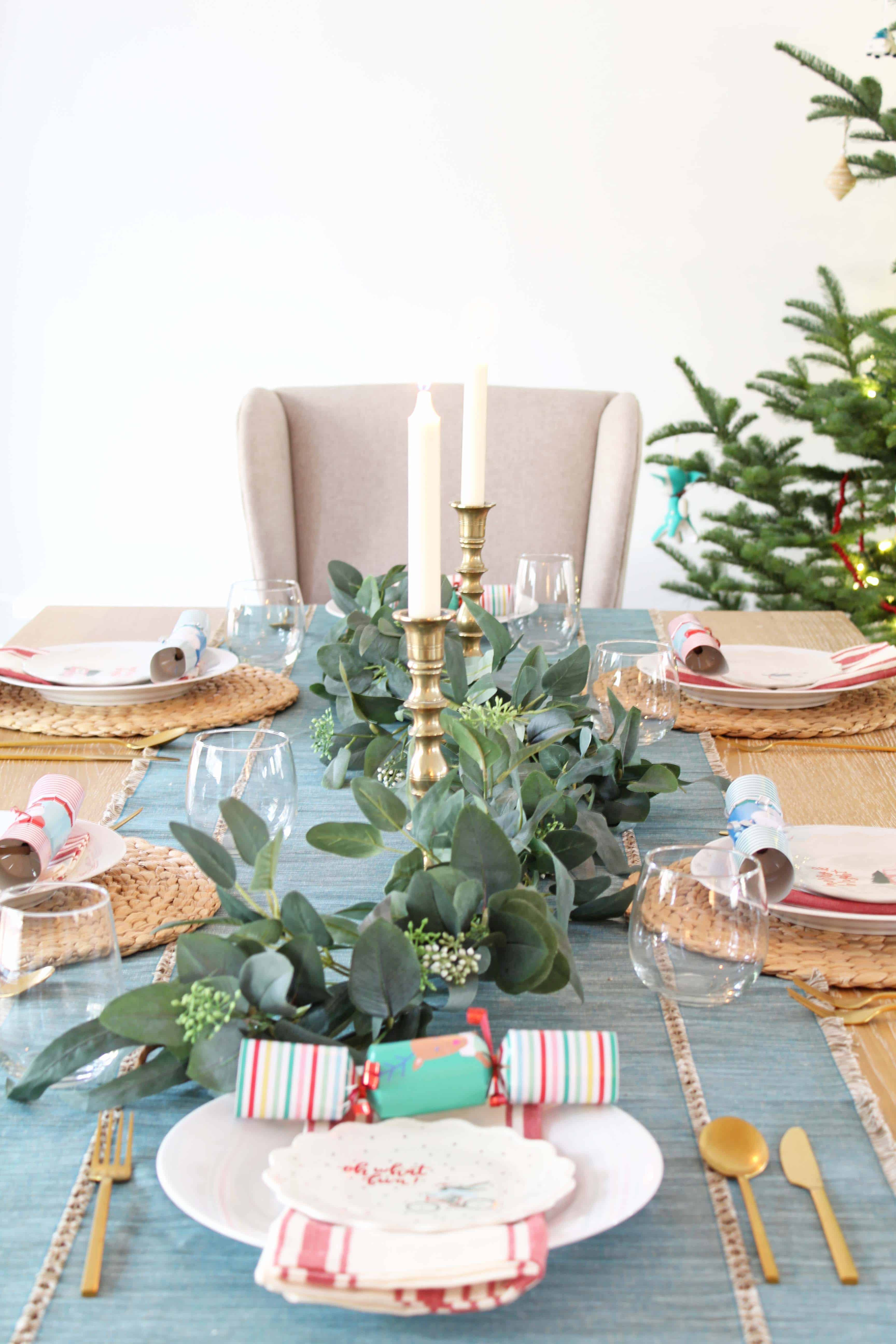 pier one dining table with eucalyptus garland