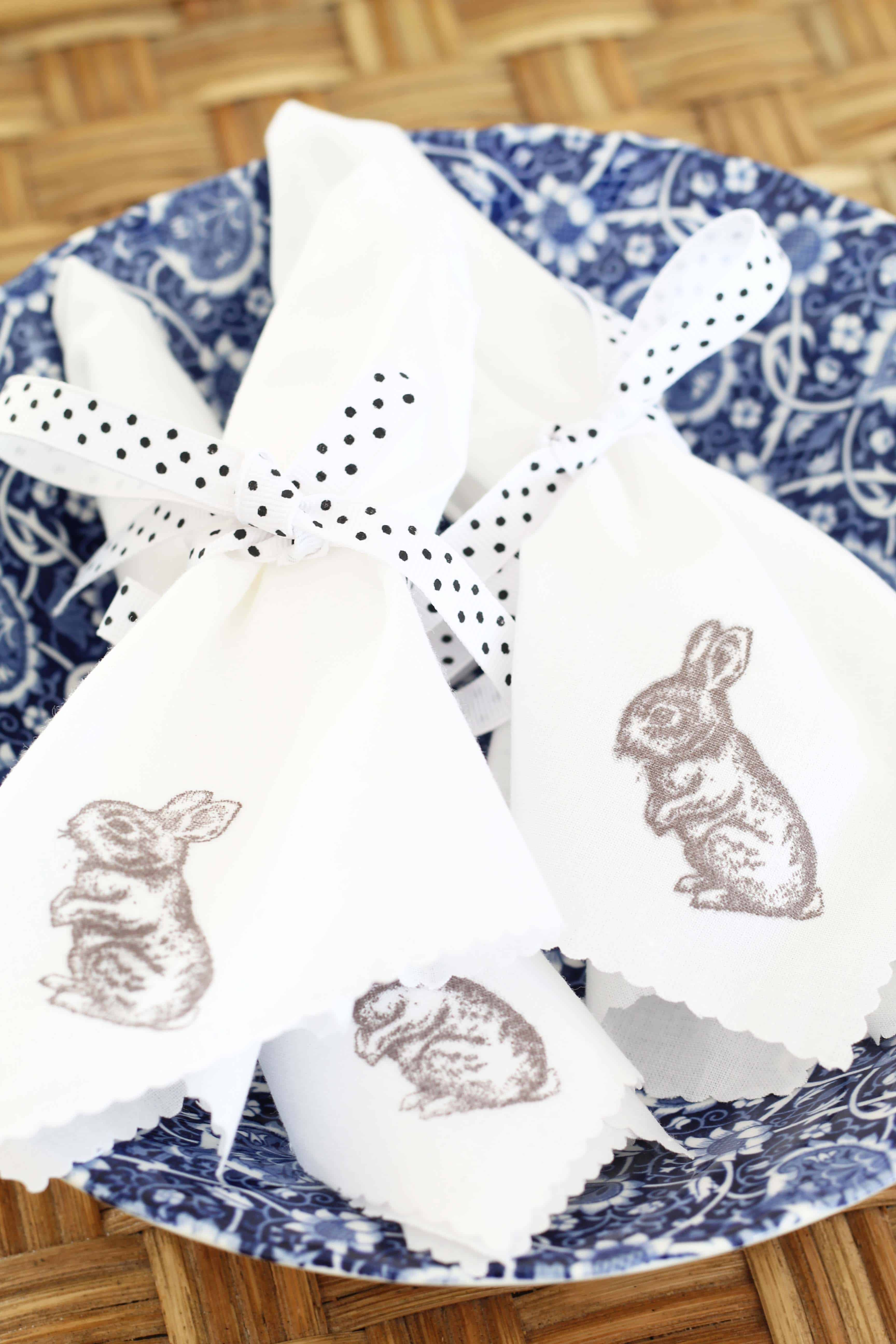 hand stamped easter bunny napkins in blue transfer ware bowl and black and white polka dot ribbon