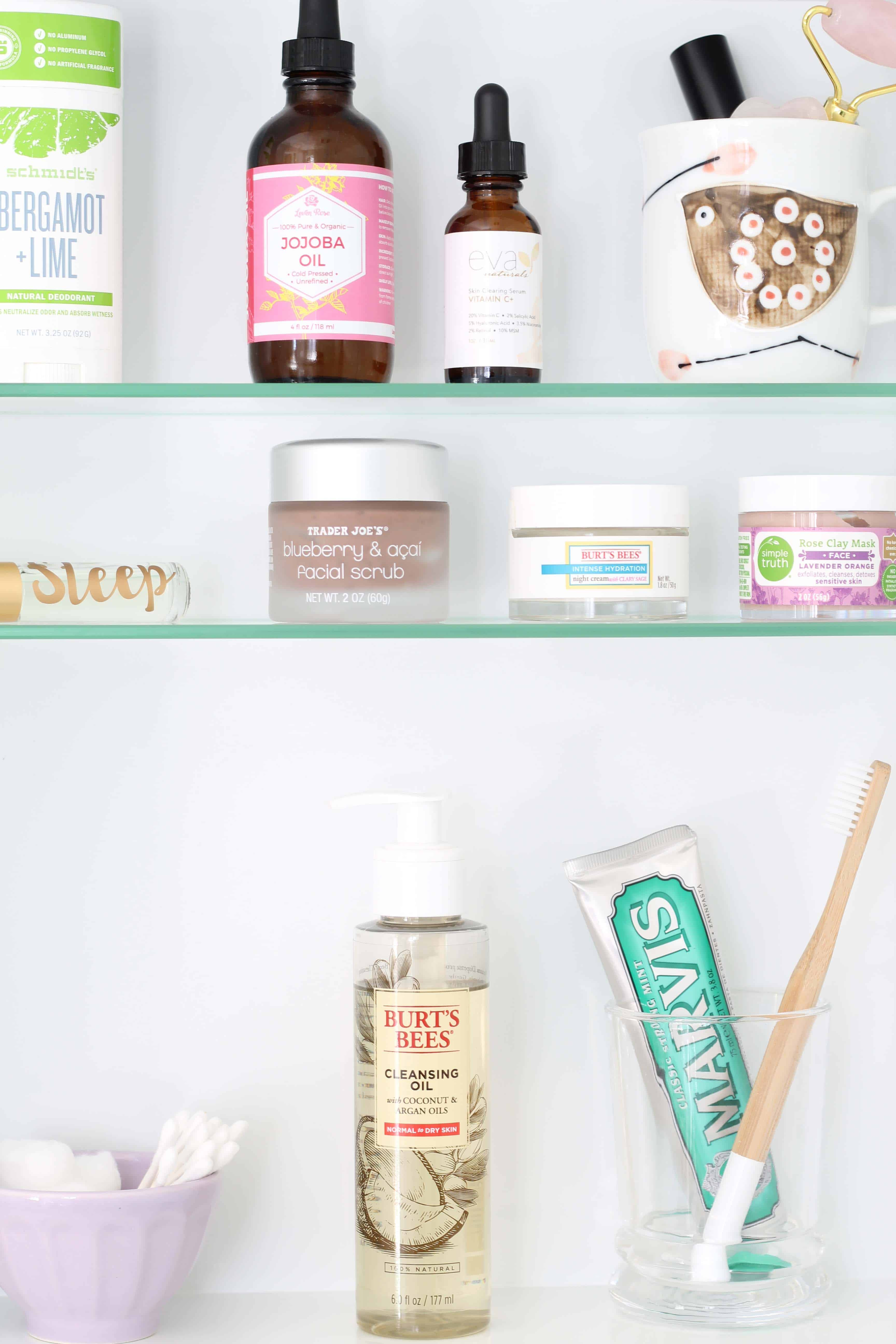 recessed medicine cabinet with marvins toothpaste, wood toothbrush, anthropologie mini latte bowl