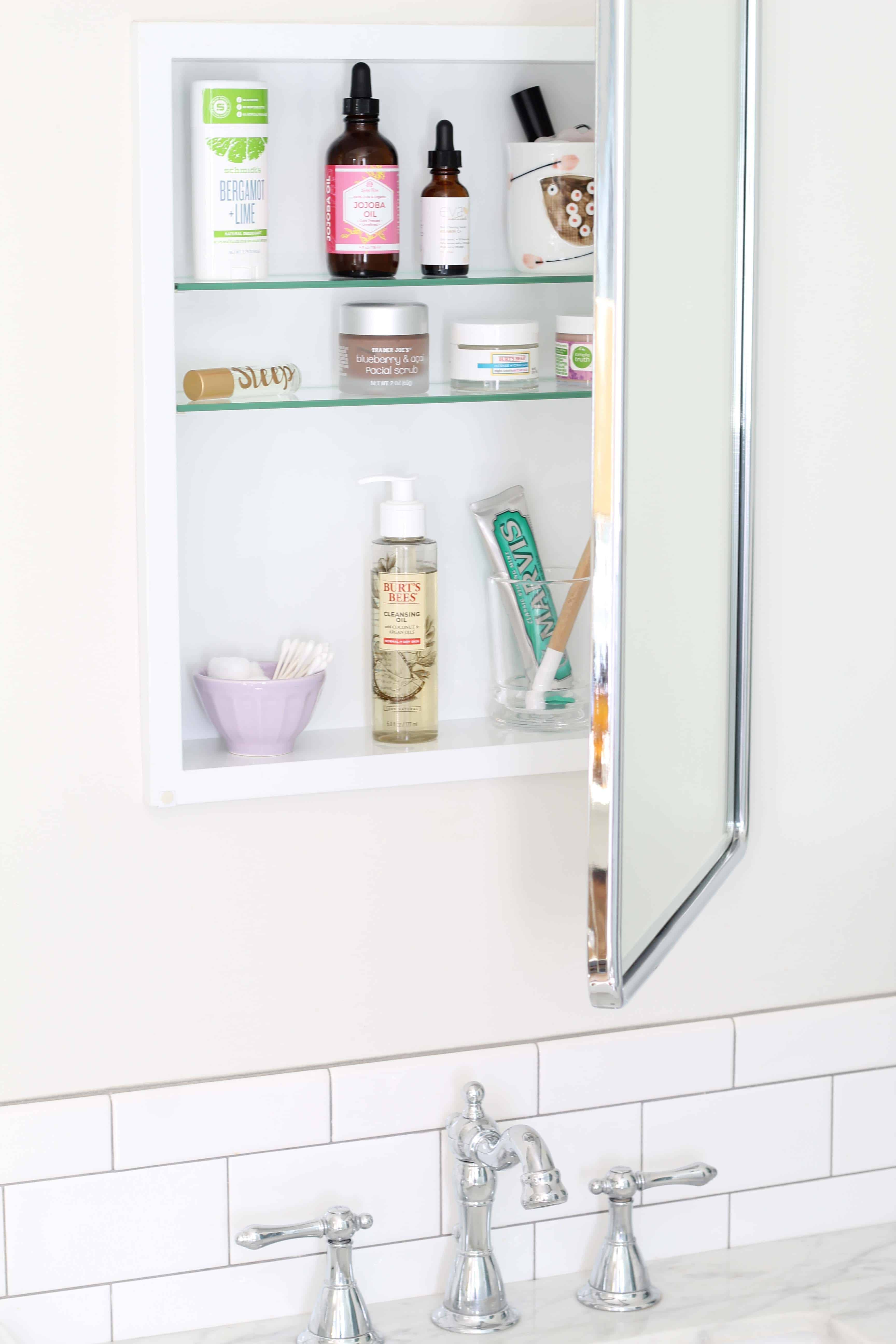 pottery barn recessed medicine cabinet with anthropologie latte bowl, jojoba oil, schmidts deodorant, wood dip dyed toothbrush