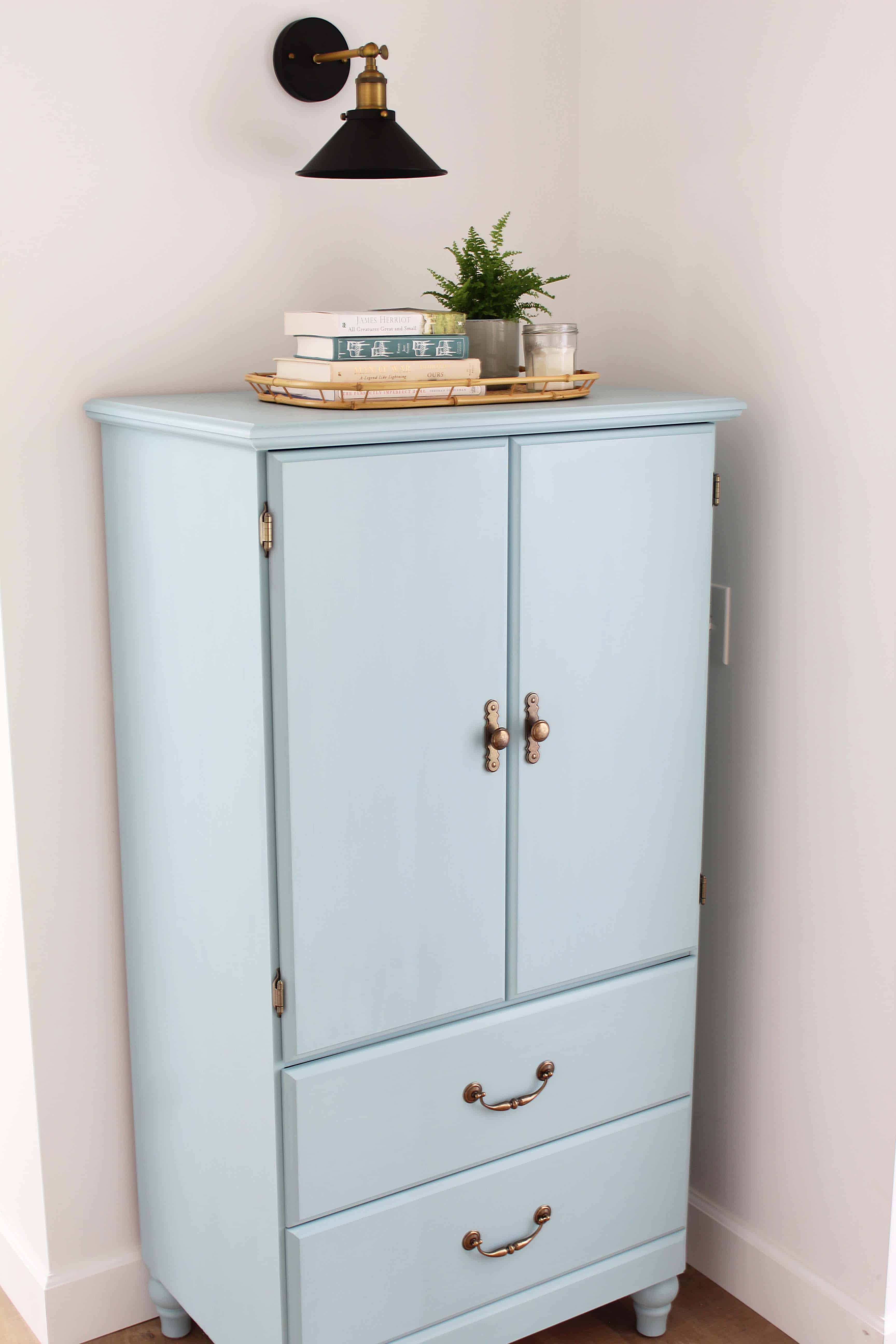small armoire painted in kilz juniper blue chalk paint, modern farmhouse black wall sconce, bamboo serving tray