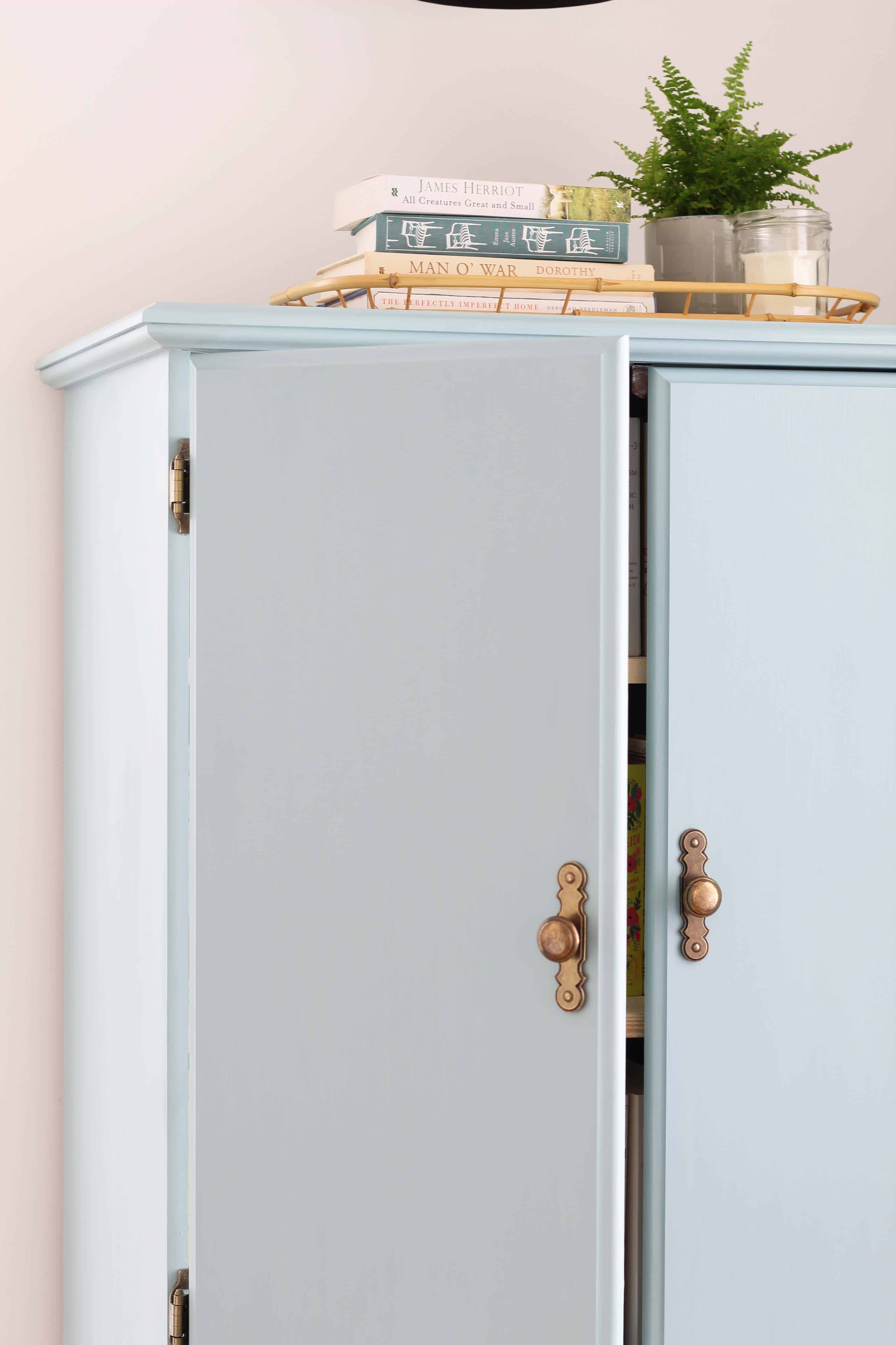 blue chalk paint cabinet with black sconce