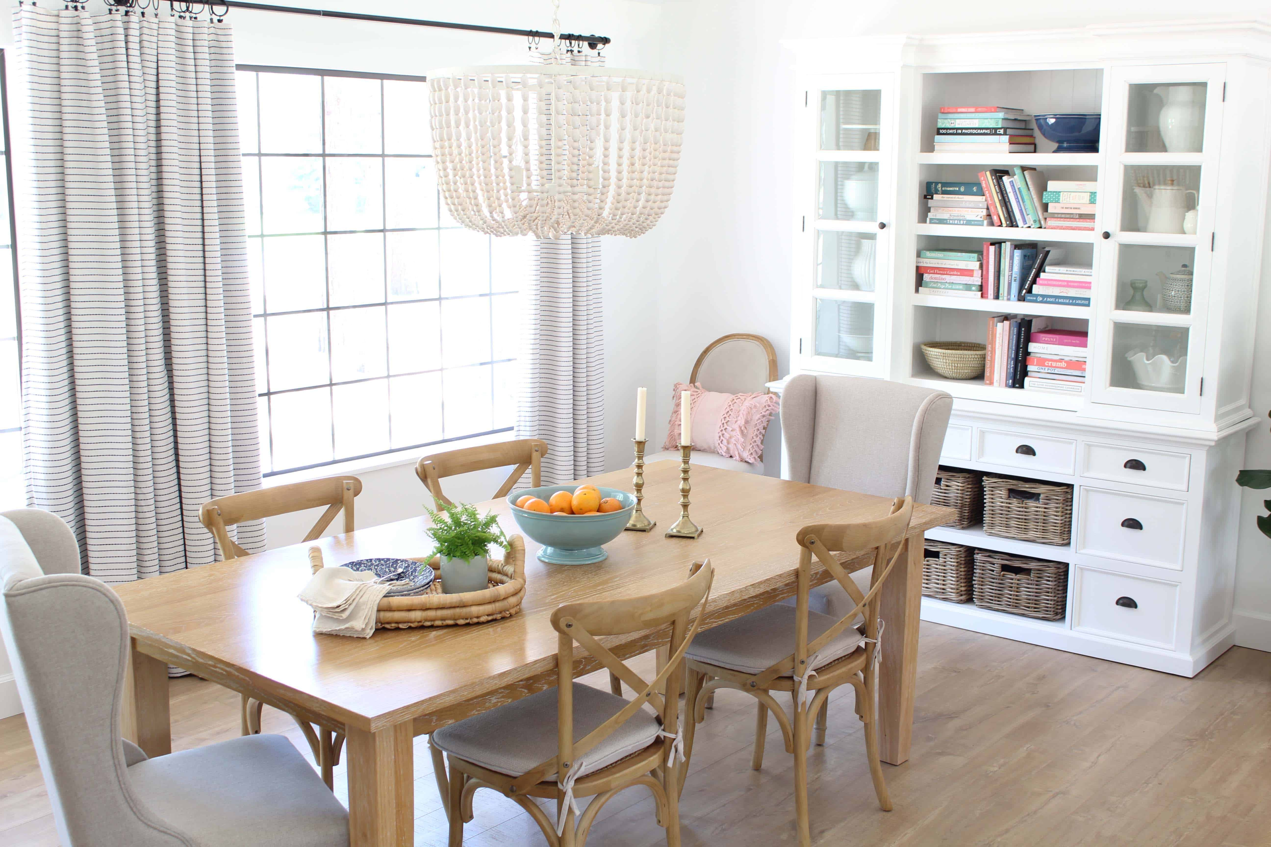 world market beaded chandelier, parsons light wood dining table, novo solo halifax library hutch
