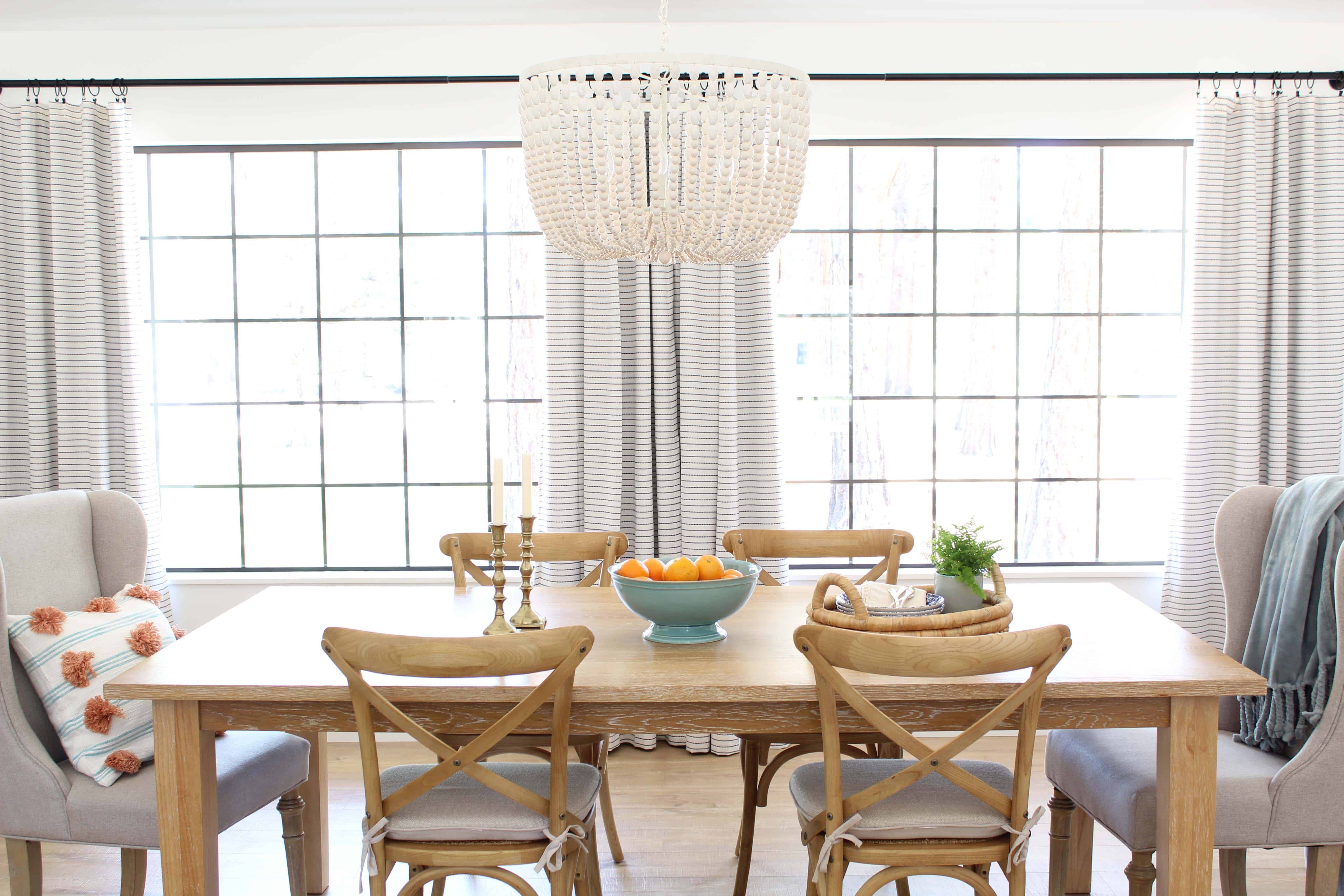 pier 1 dining room table, farmhouse bistro chairs, world market beaded chandelier