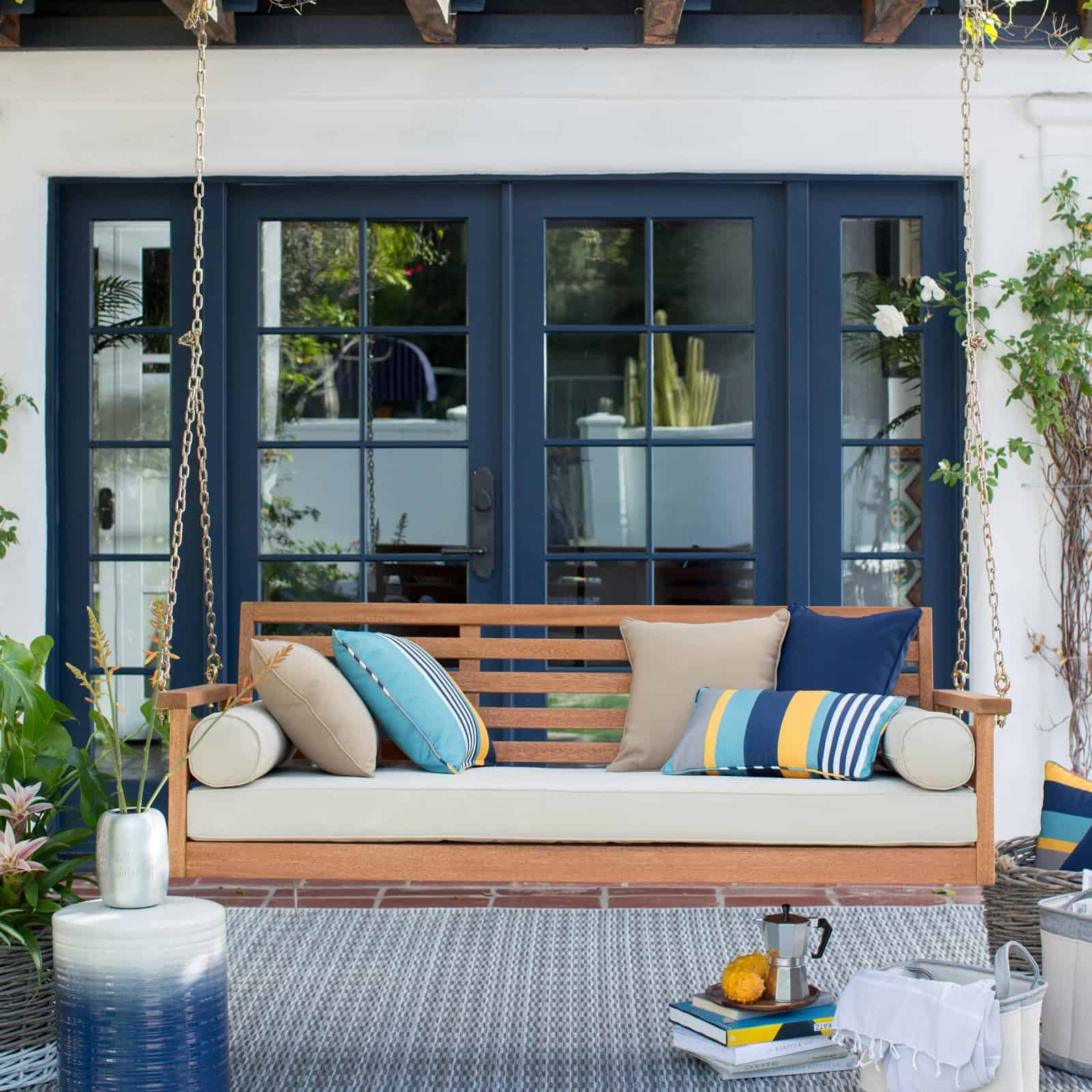 beldam living porch swing, navy blue french doors, natural wood porch swing