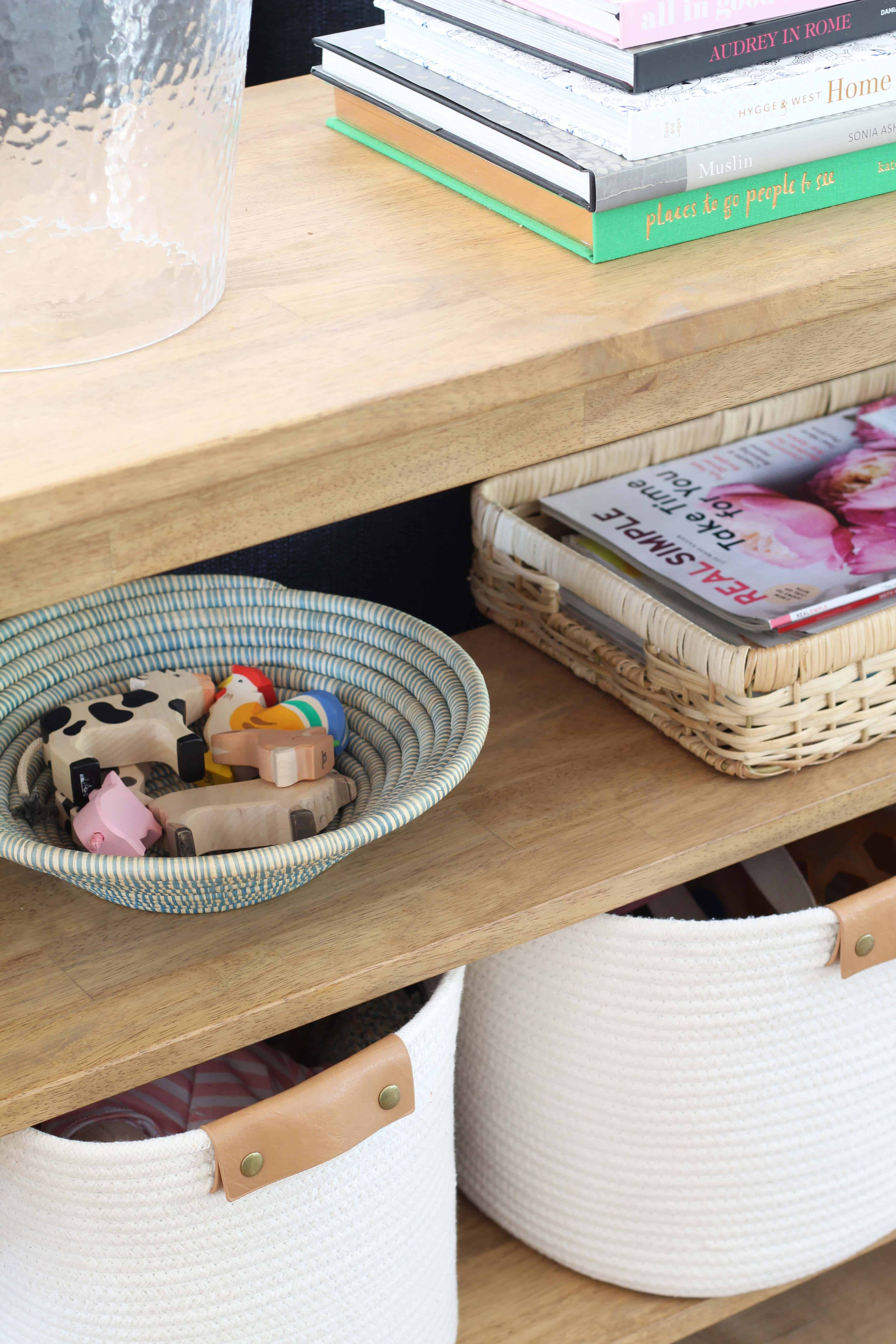farmhouse console table, wooden toy animals, target rope baskets with leather handles
