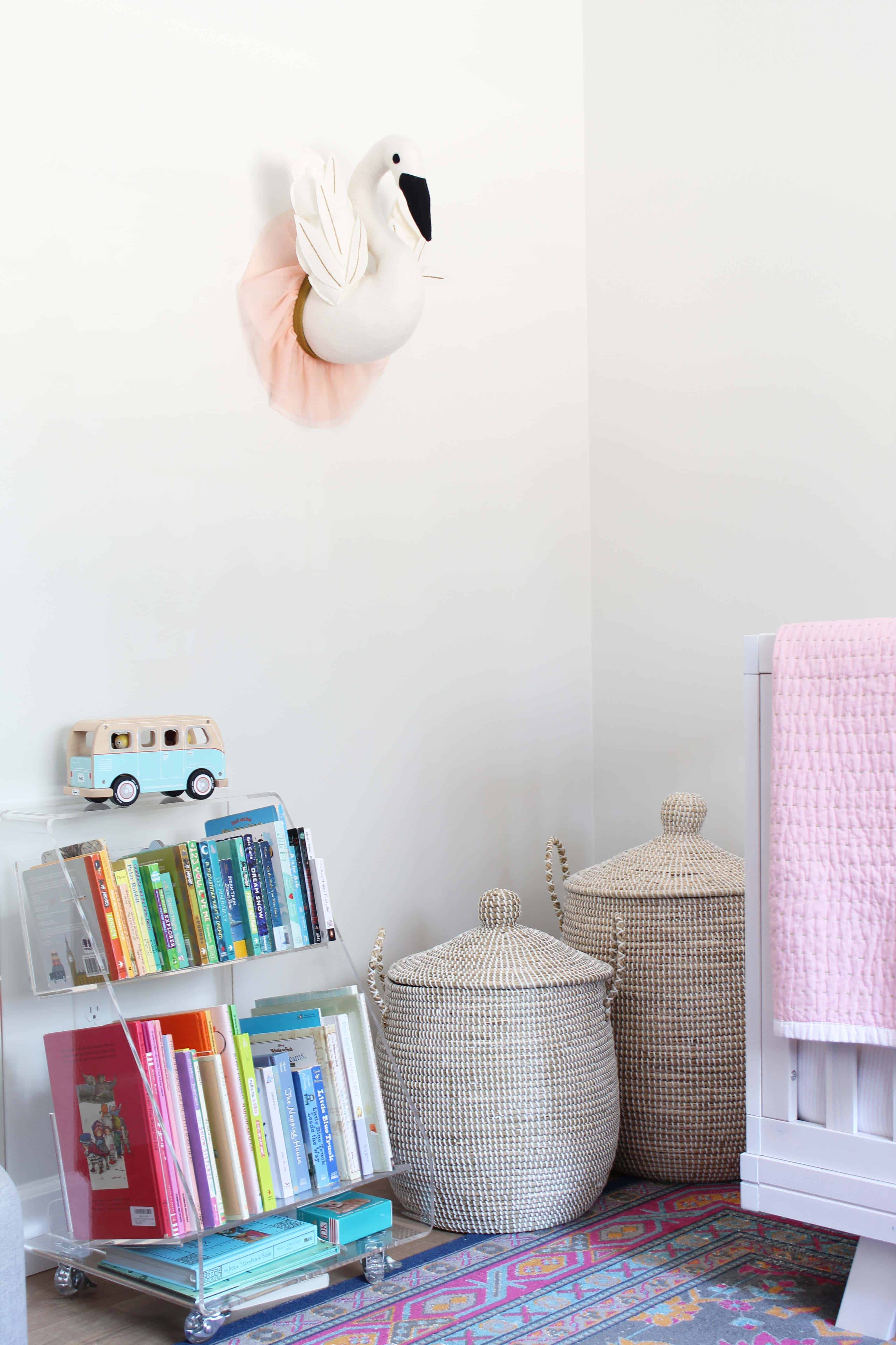 taget stuffed swan wall bust, crate and barrel kids acrylic book cart, serena and lily lidded baskets