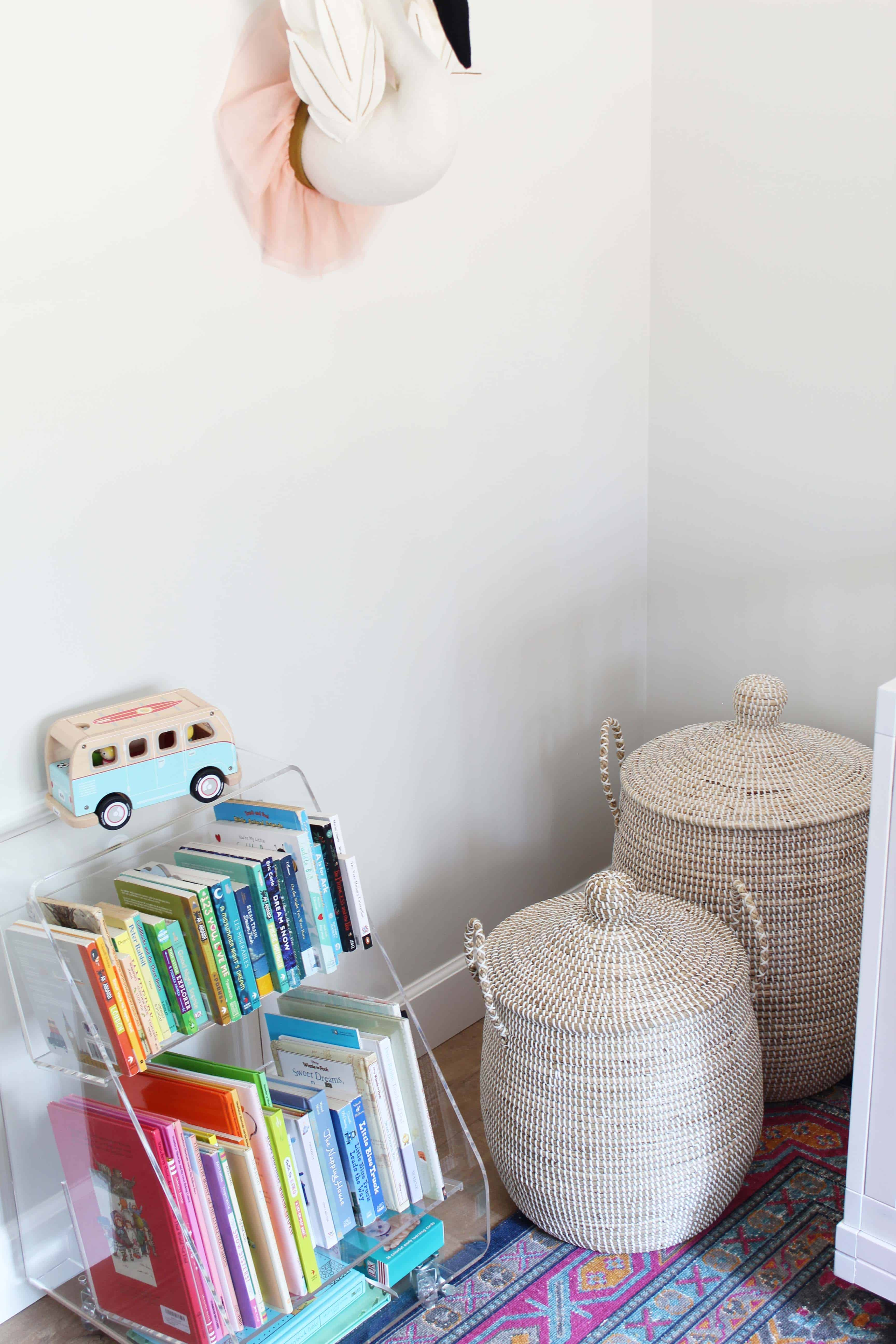 target swan wall head, serena and lily lidded baskets, crate and kids acrylic book cart