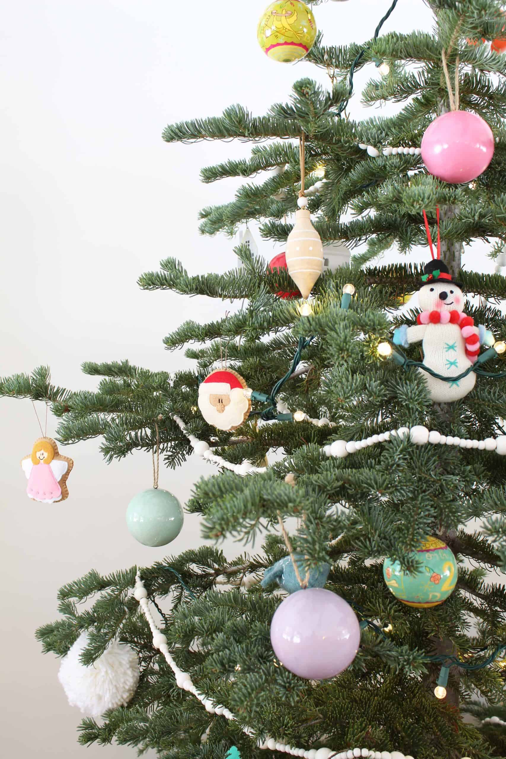 noble fir christmas tree with felt ornaments and land of nod colorful christmas ball ornaments