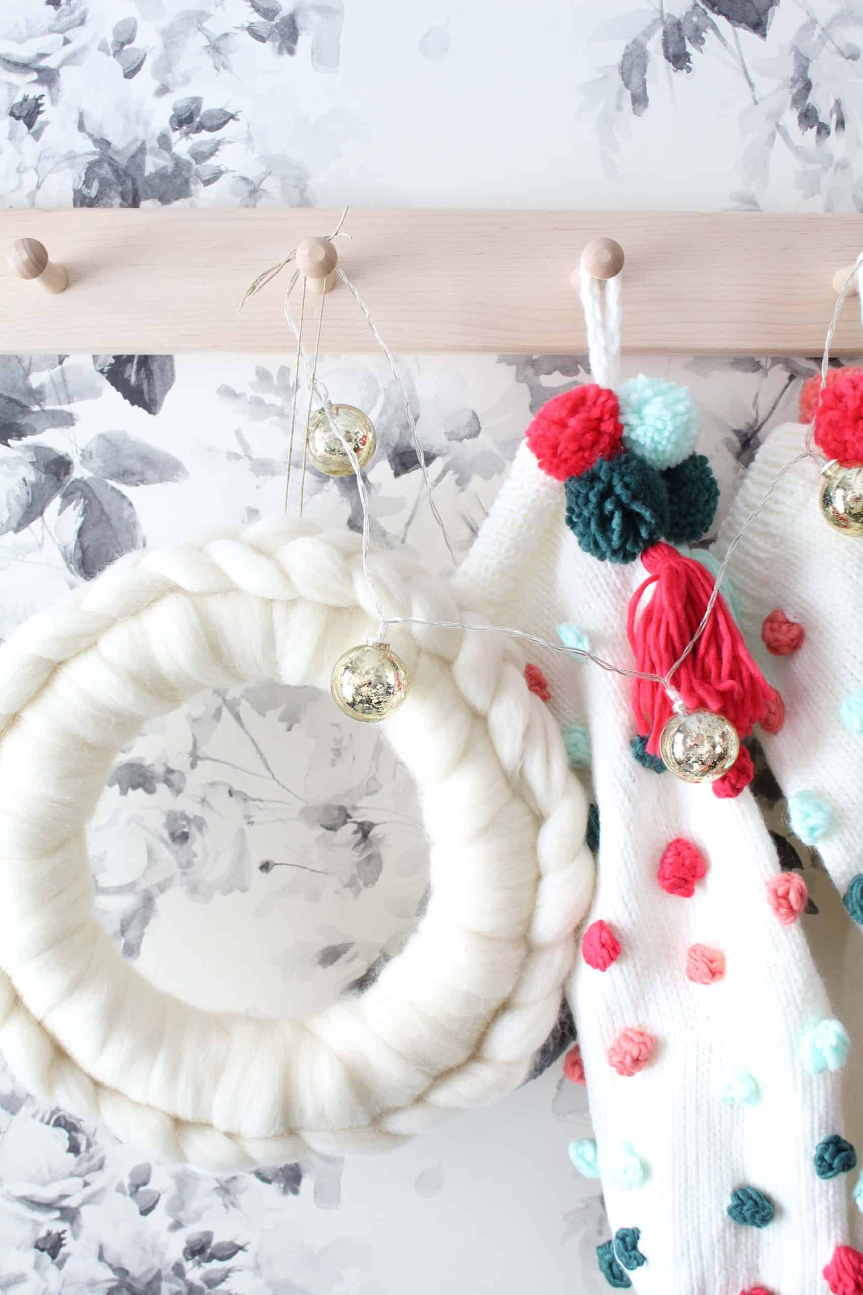 anthropologie white wool wreath, anthropologie christmas wreath, diy anthropologie wreath, anthropologie pom pom christmas stockings, smoky rose wallpaper by house of hackney