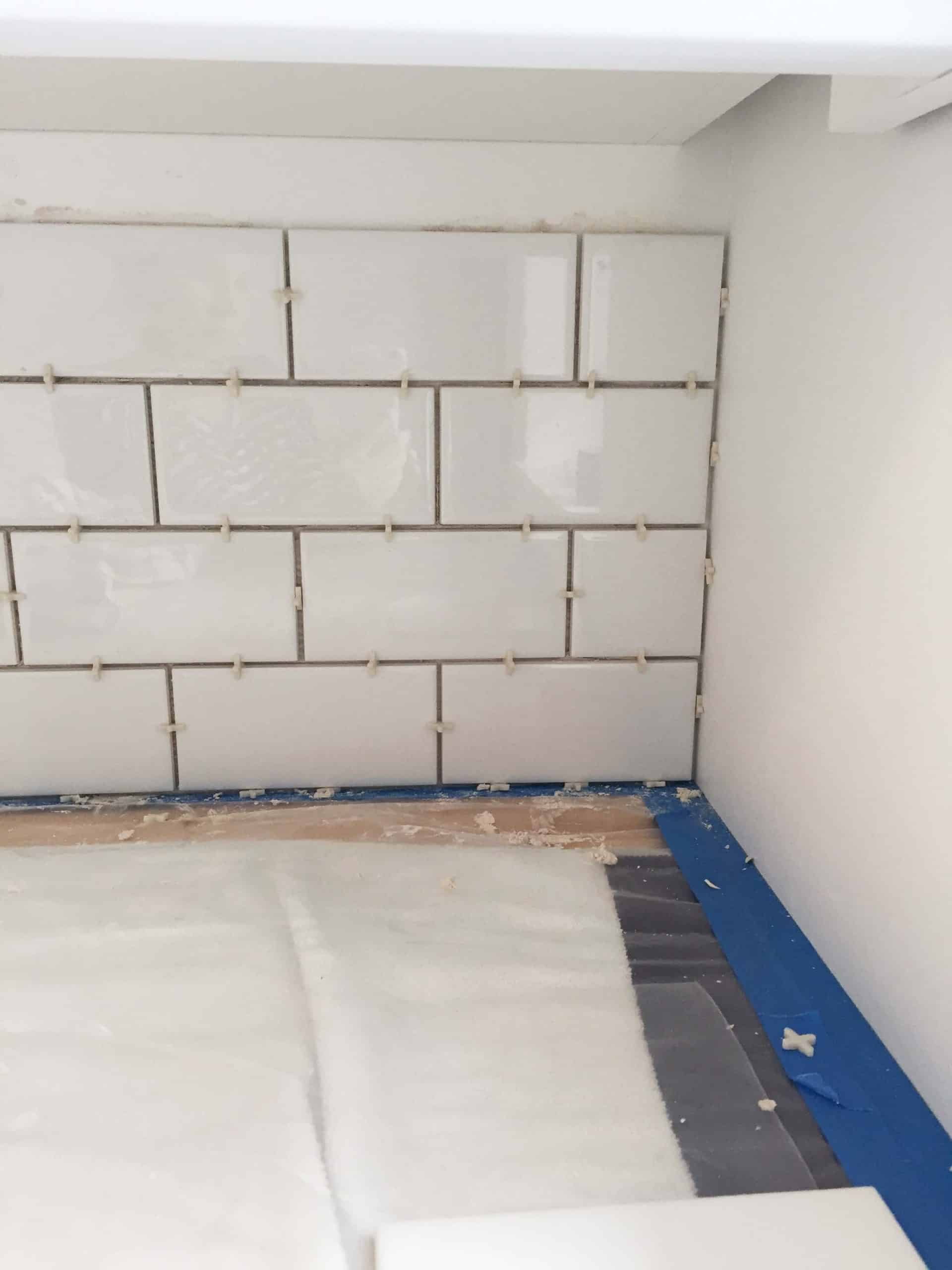 white subway tile backsplash in laundry room with 1/8 inch spacers
