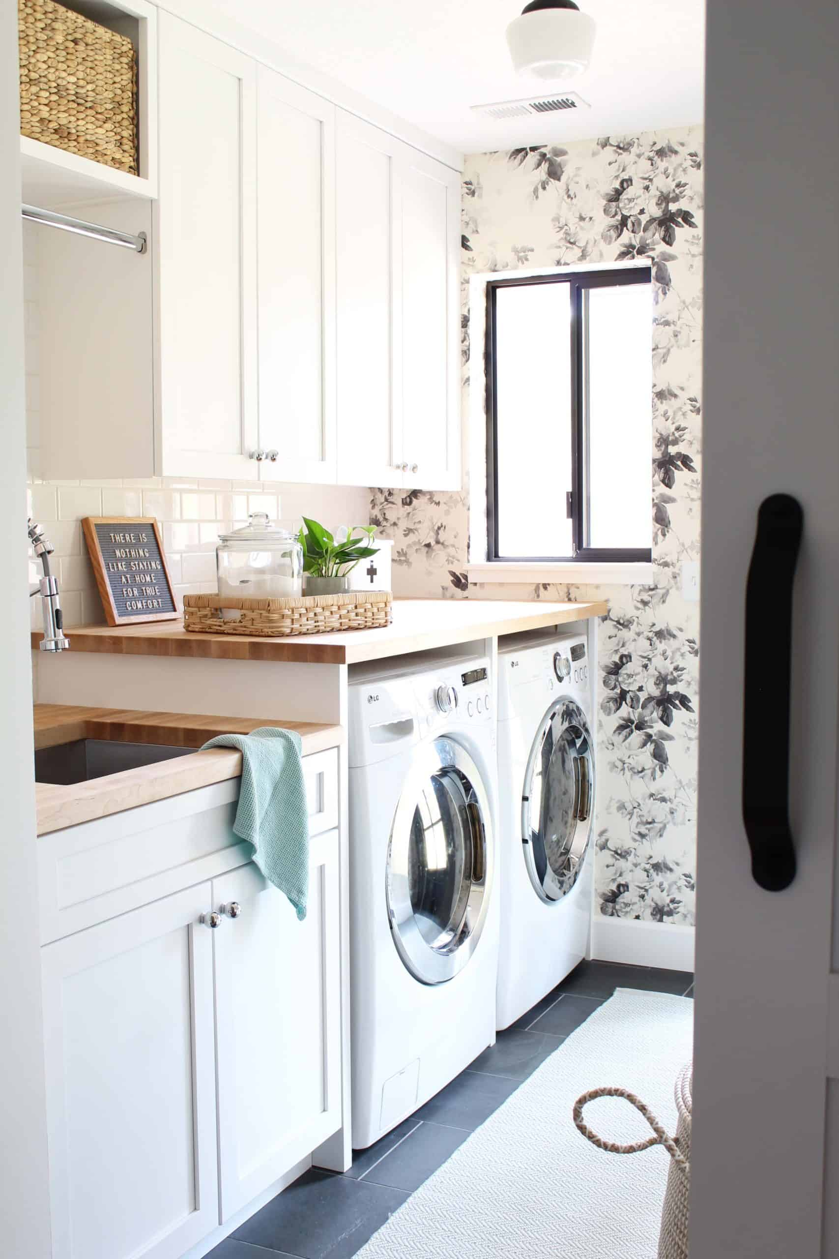 house of hackney smoky rose wallpaper, laundry room with butcher block counter tops, laundry room with slate tile floor, laundry room with two different height countertops, laundry room with white shaker cabinets, laundry room with white barn door