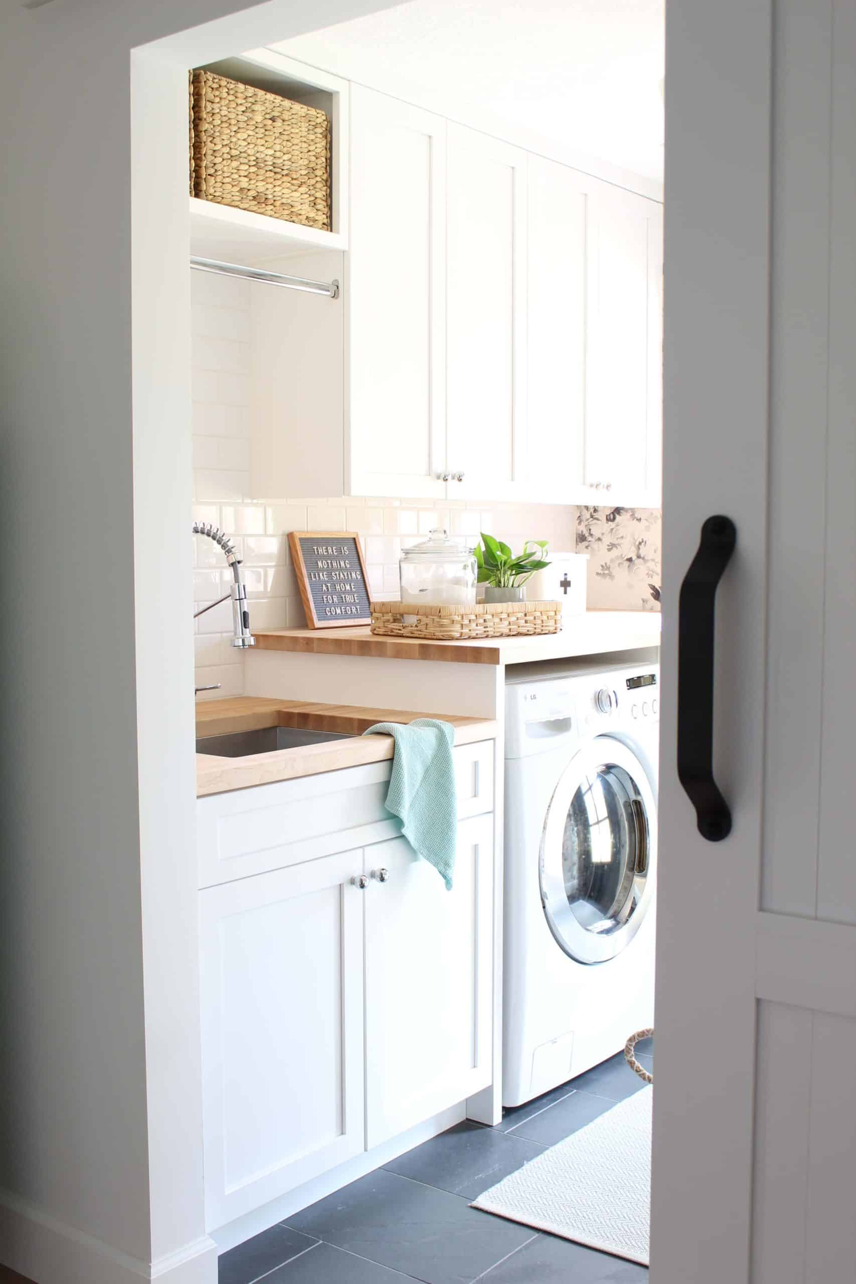 house of hackney smoky rose wallpaper, laundry room with butcher block counter tops, laundry room with slate tile floor, laundry room with two different height countertops, laundry room with white shaker cabinets