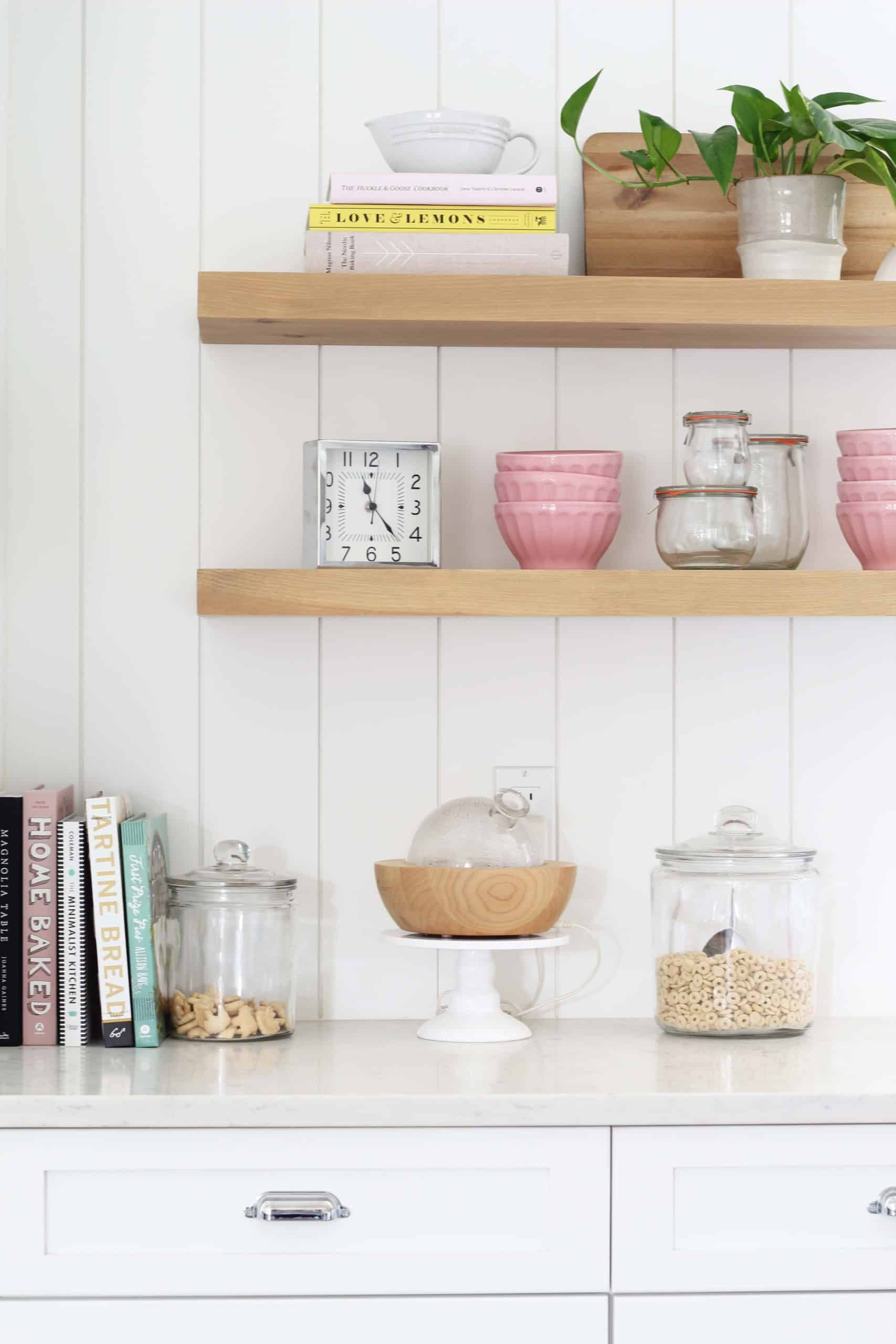open kitchen shelves, pink bowls, vertical shiplap backsplash, white modern farmhouse kitchen