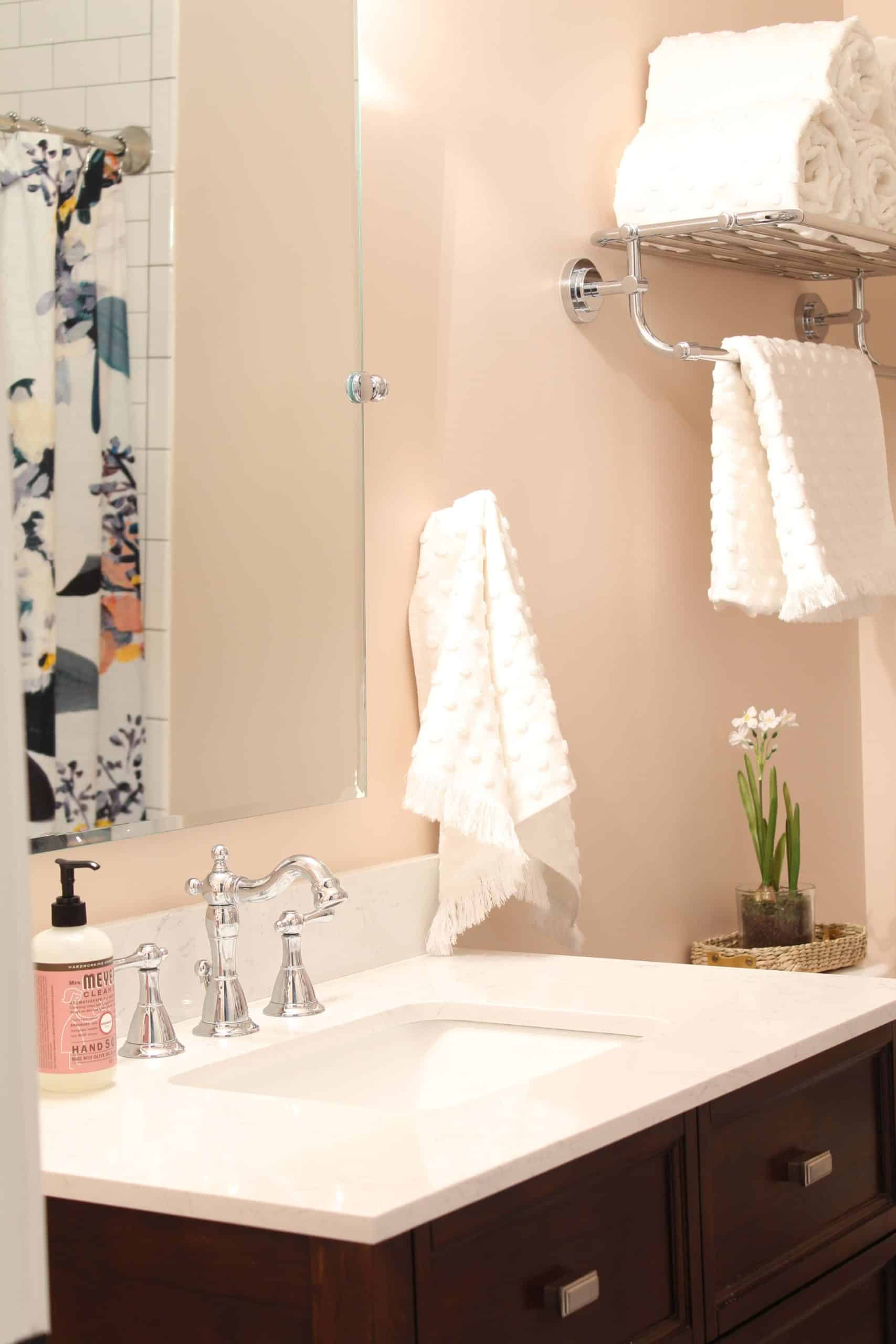 anthropologie botanica shower curtain, bathroom with pink walls, white polka dot towels, white subway tile shower surround, bathroom with hotel towel rack
