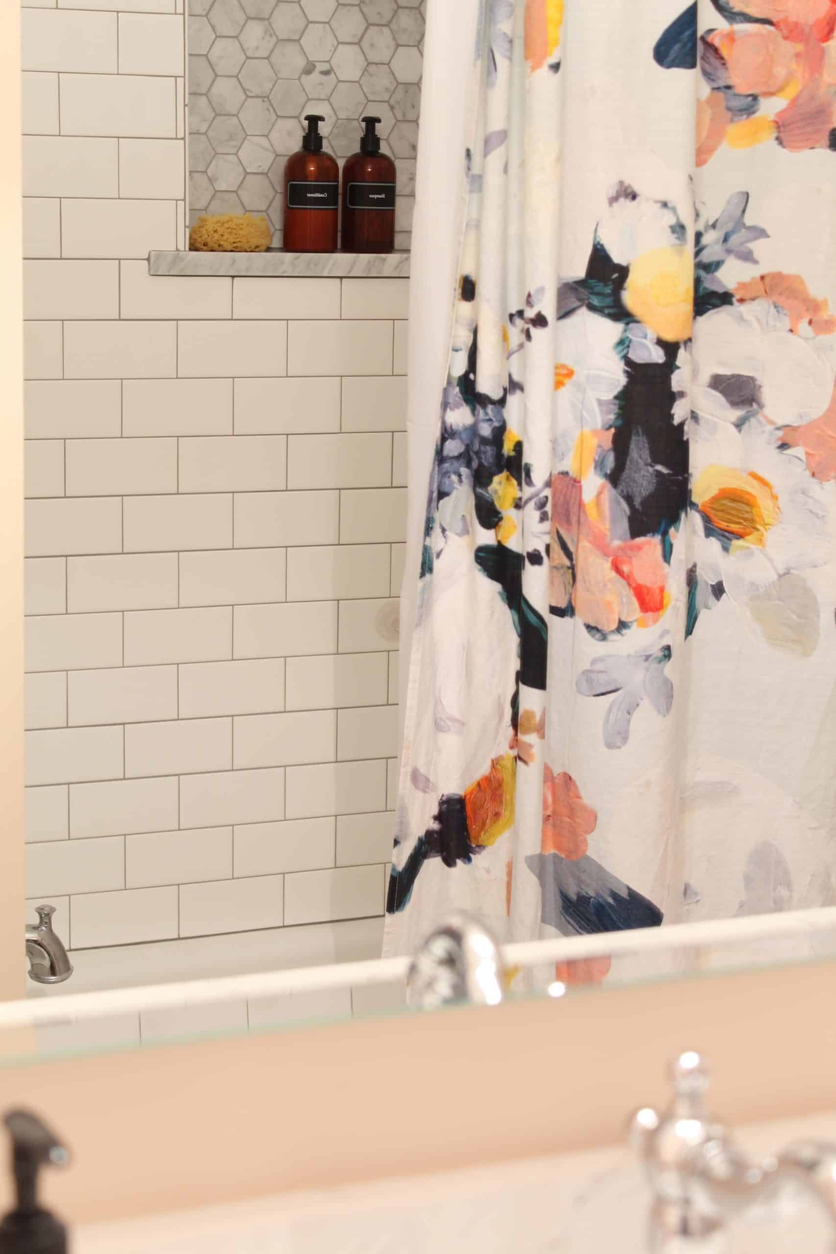anthropologie botanica shower curtain, bathroom with pink walls, white subway tile shower surround,