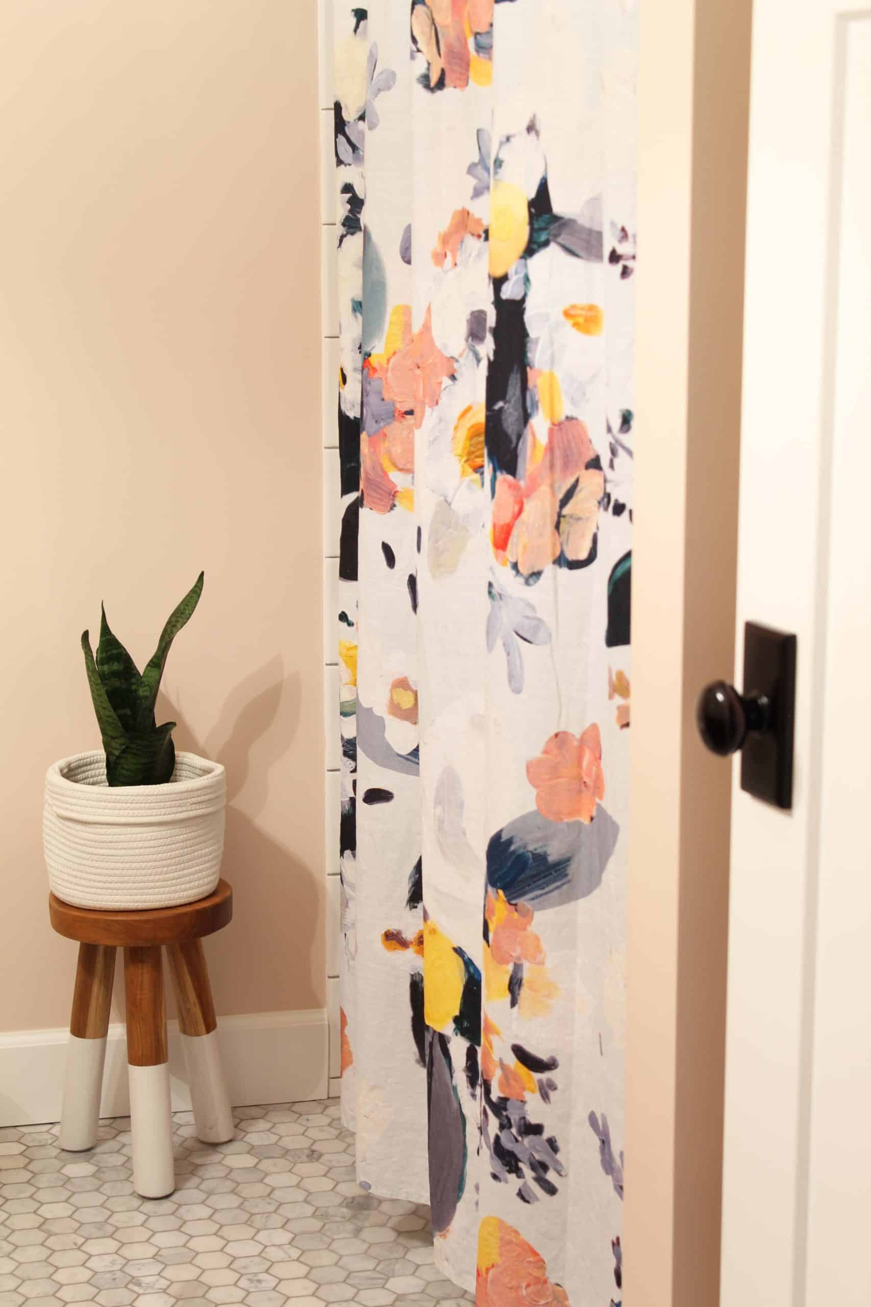 anthropologie botanica shower curtain, bathroom with pink walls, serena and lily dipped stool in bathroom with snake plant