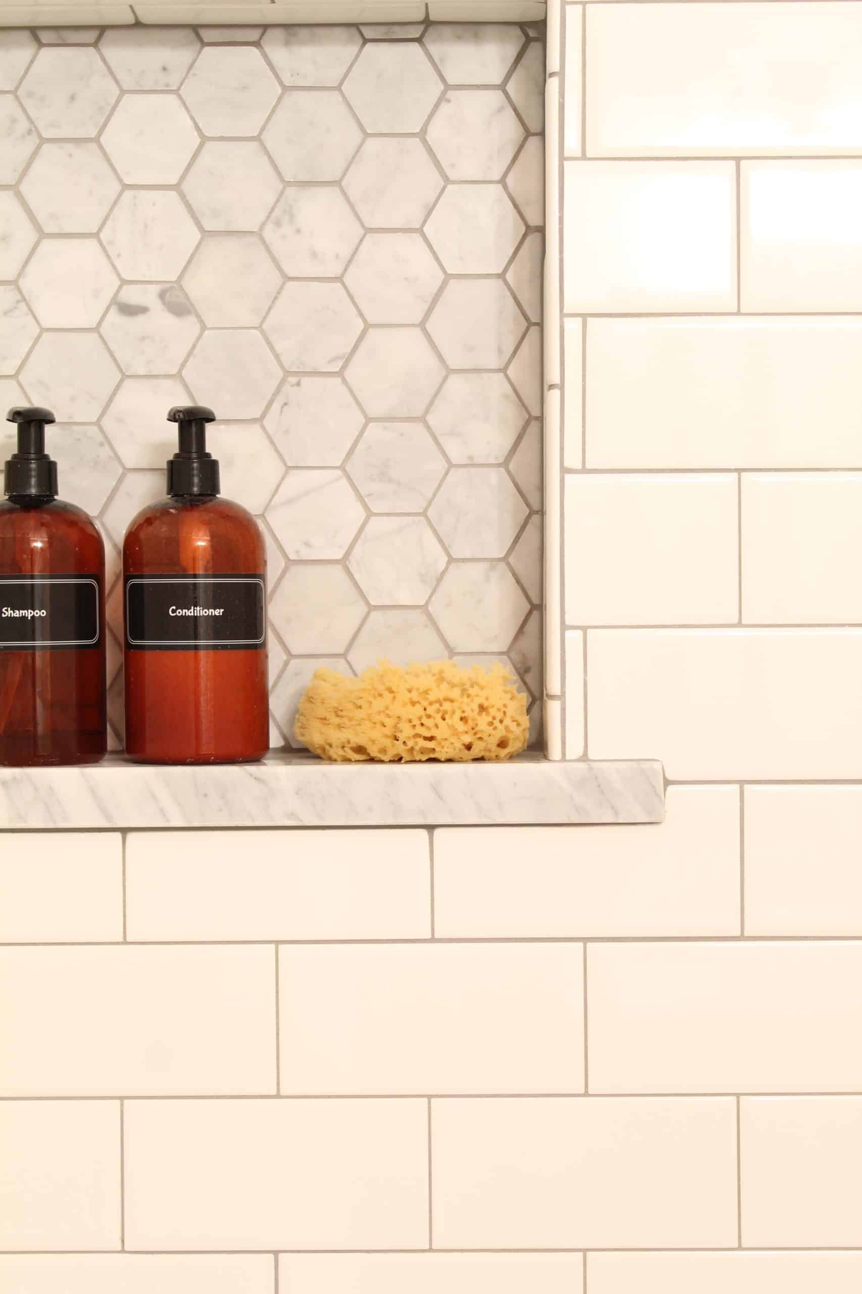 anthropologie botanica shower curtain, bathroom with pink walls, white subway tile shower surround, amber shampoo and conditioner bottles