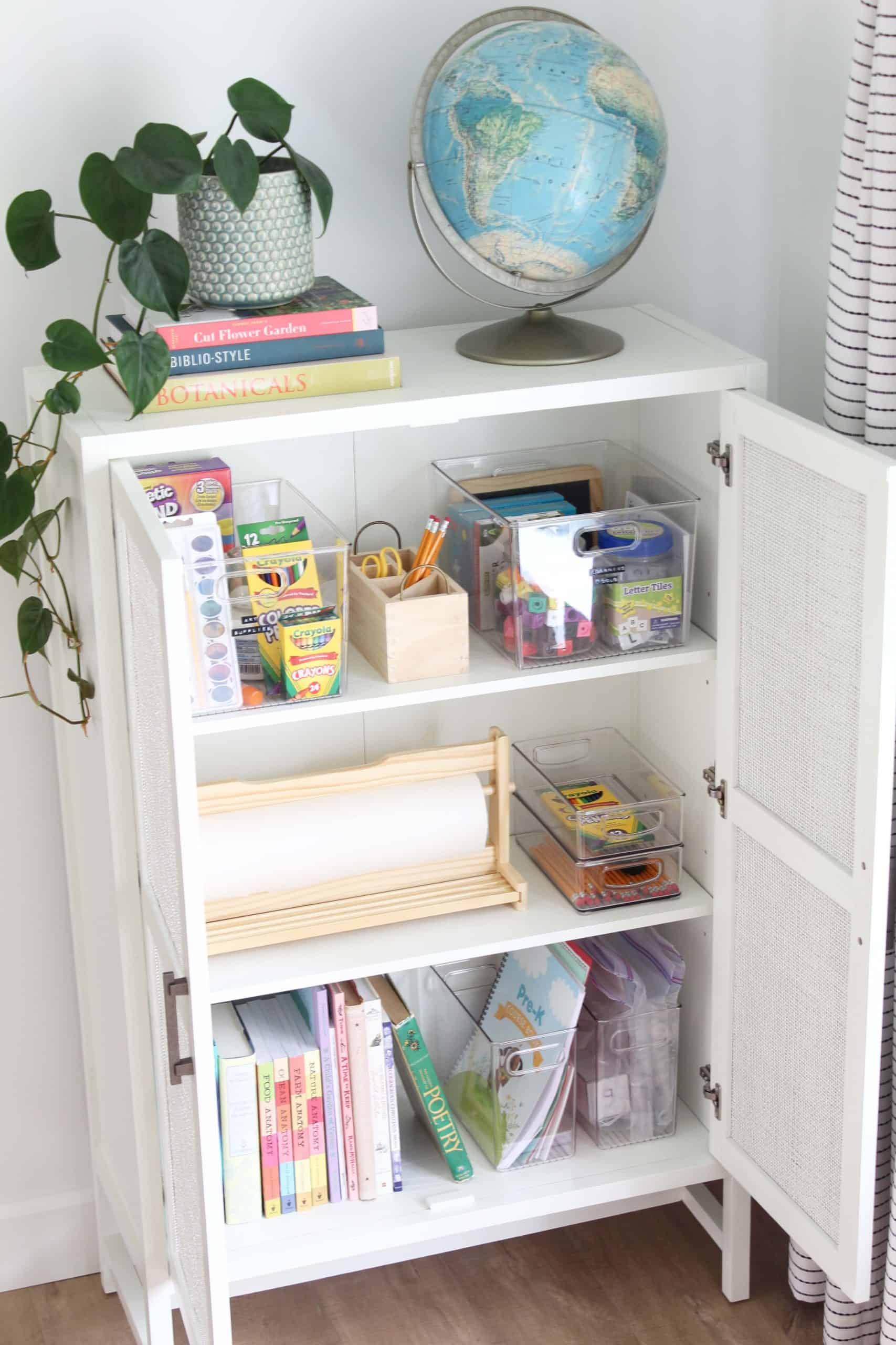 target warwick library cabinet in white, vintage globe, heart leaf philodendron, ikea paper dispenser, homeschool supplies, homeschool cabinet