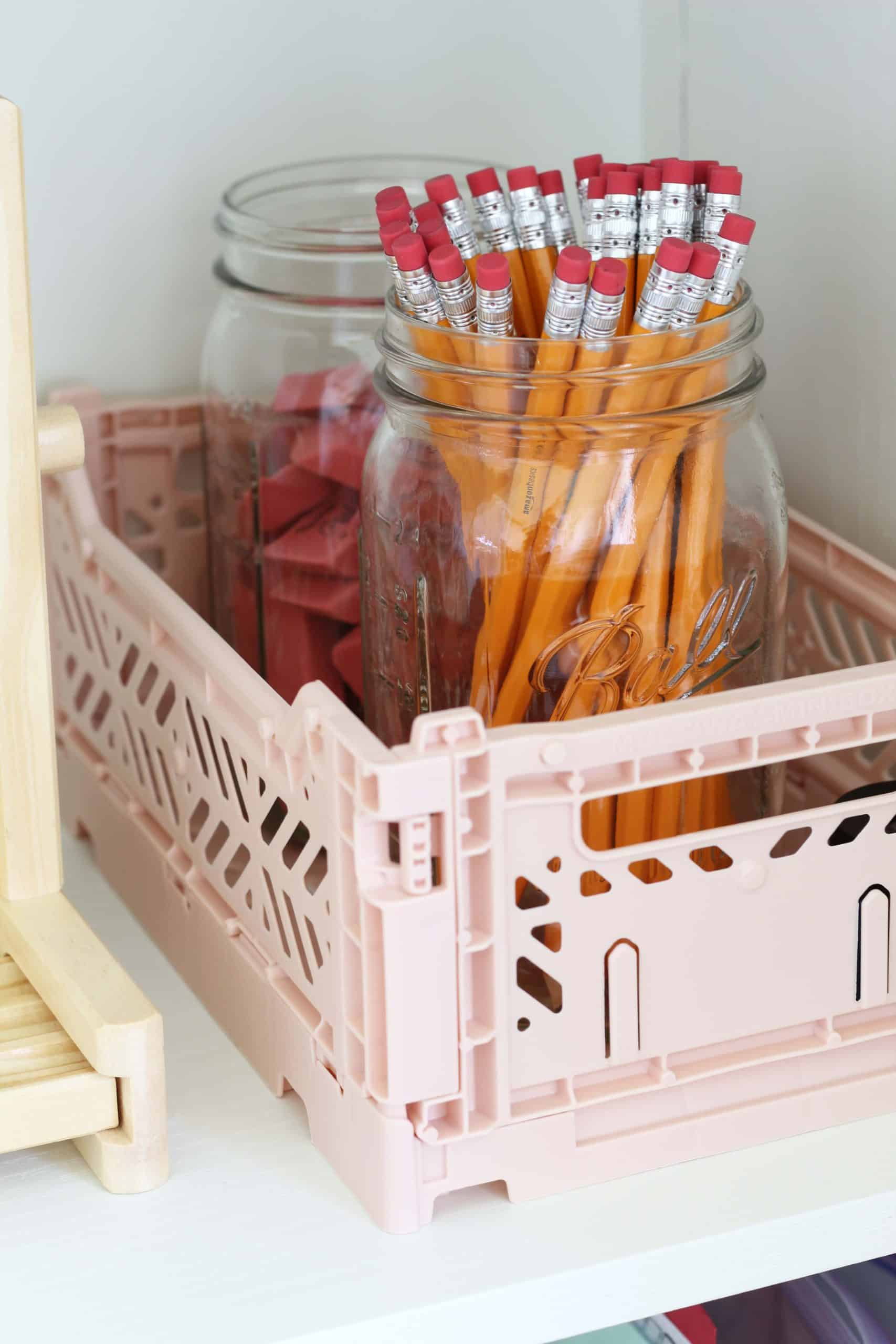 pencils in wide mouth ball jar, pink pearl erasers in wide mouth ball jar, pink hay crate, pink milk crate
