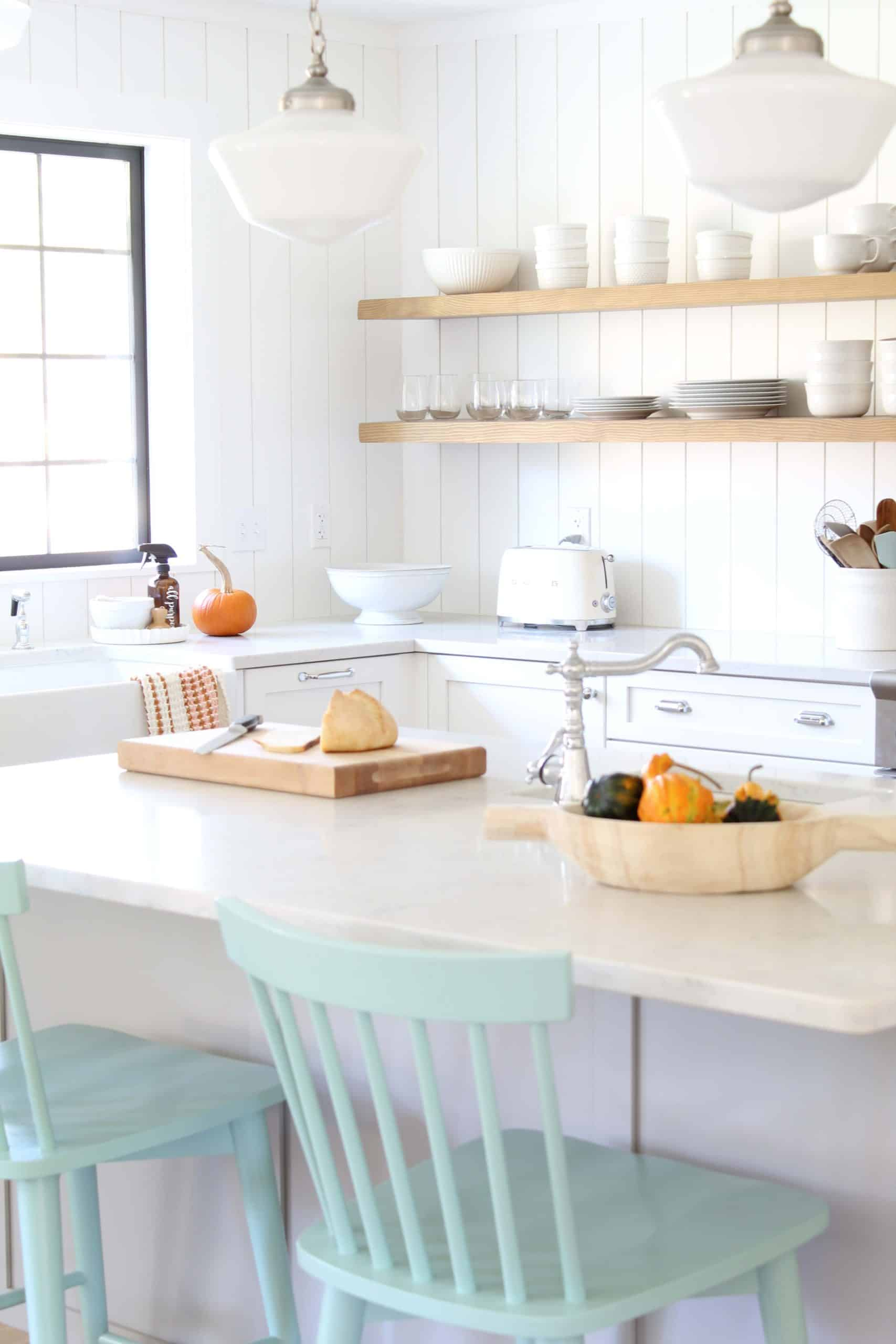 white kitchen with vertical tongue and groove backsplash
