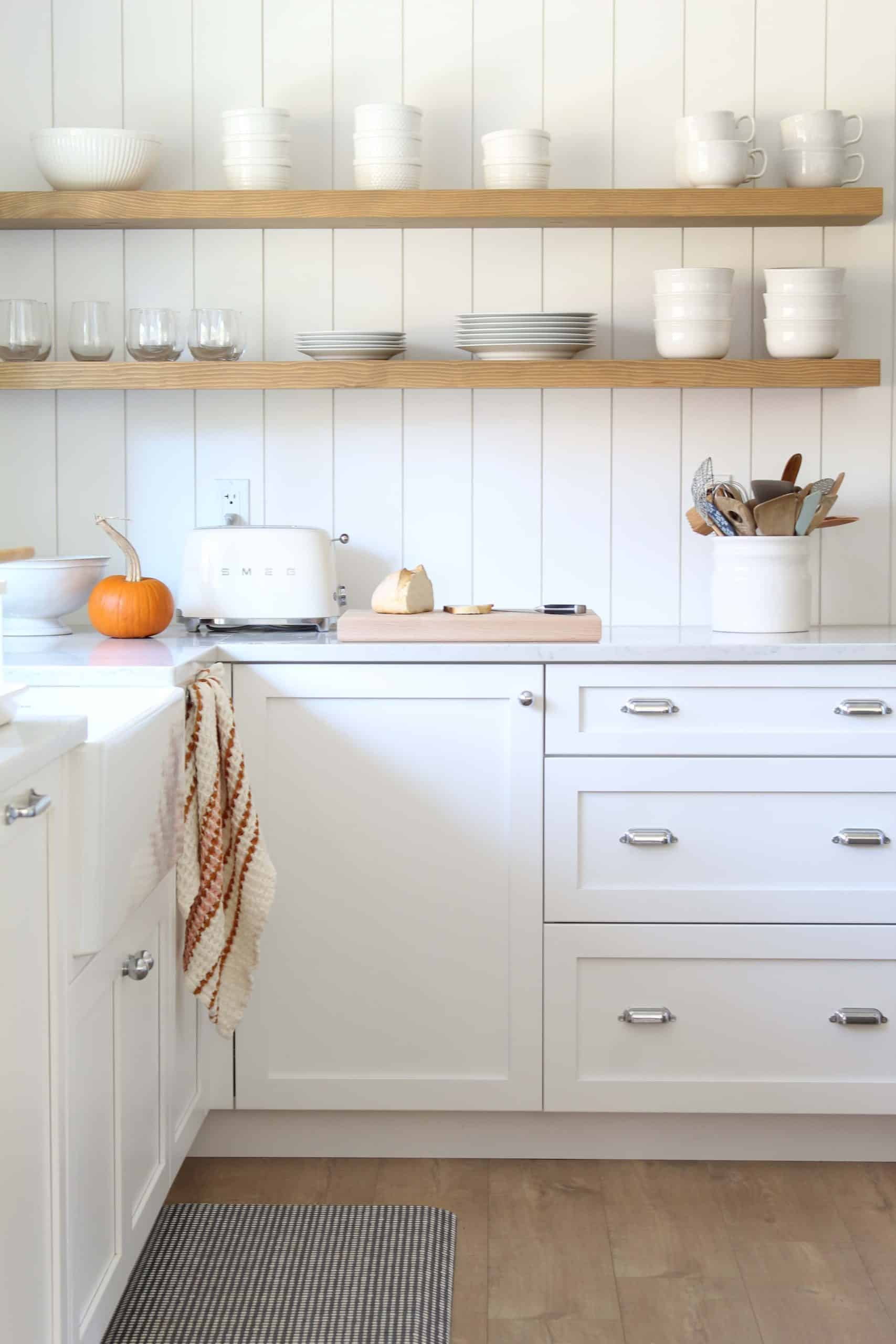 open kitchen shelving with white dished and smeg toaster