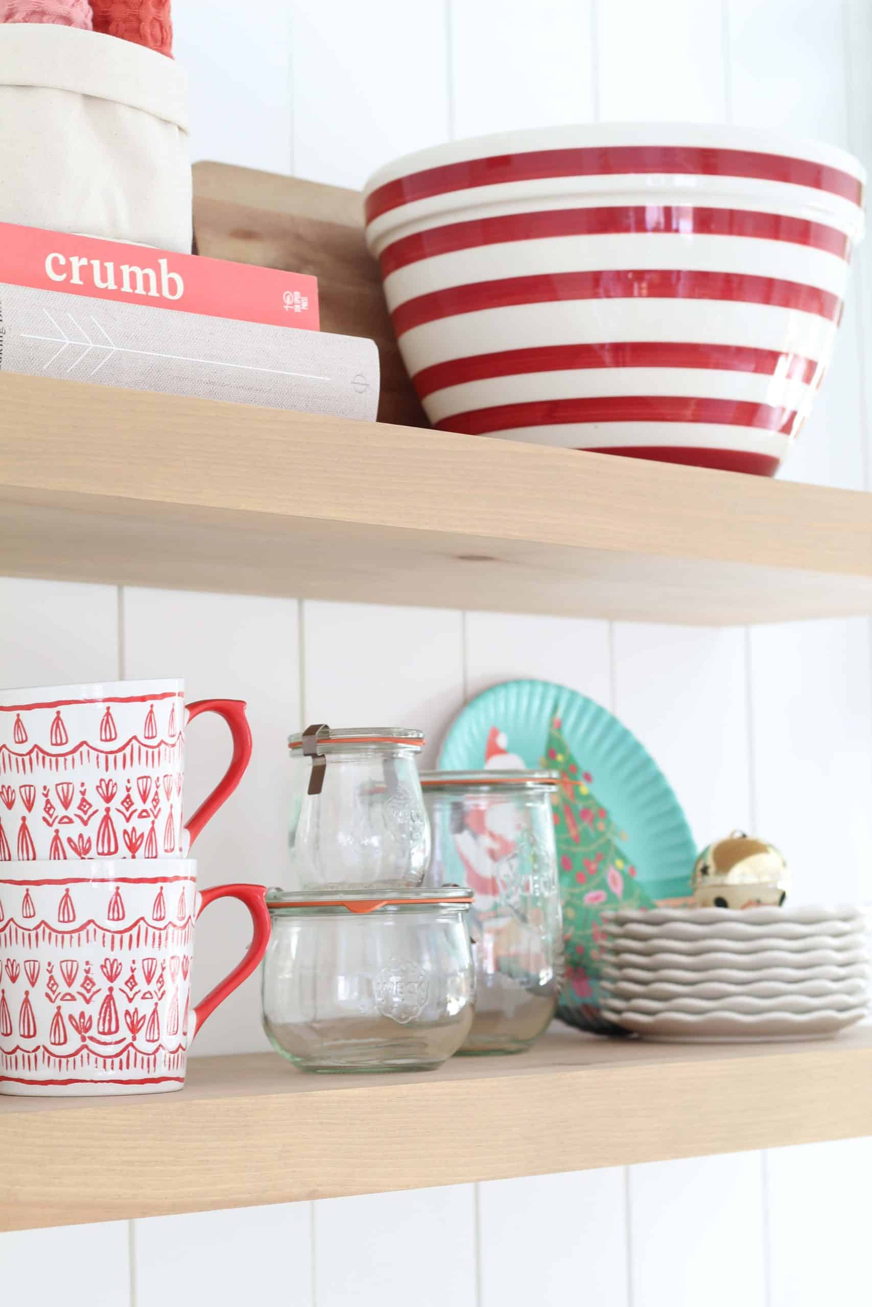 farmhouse kitchen with open shelving, crate and barrel red striped bowl, tulip wreck jars, melamine christmas plates