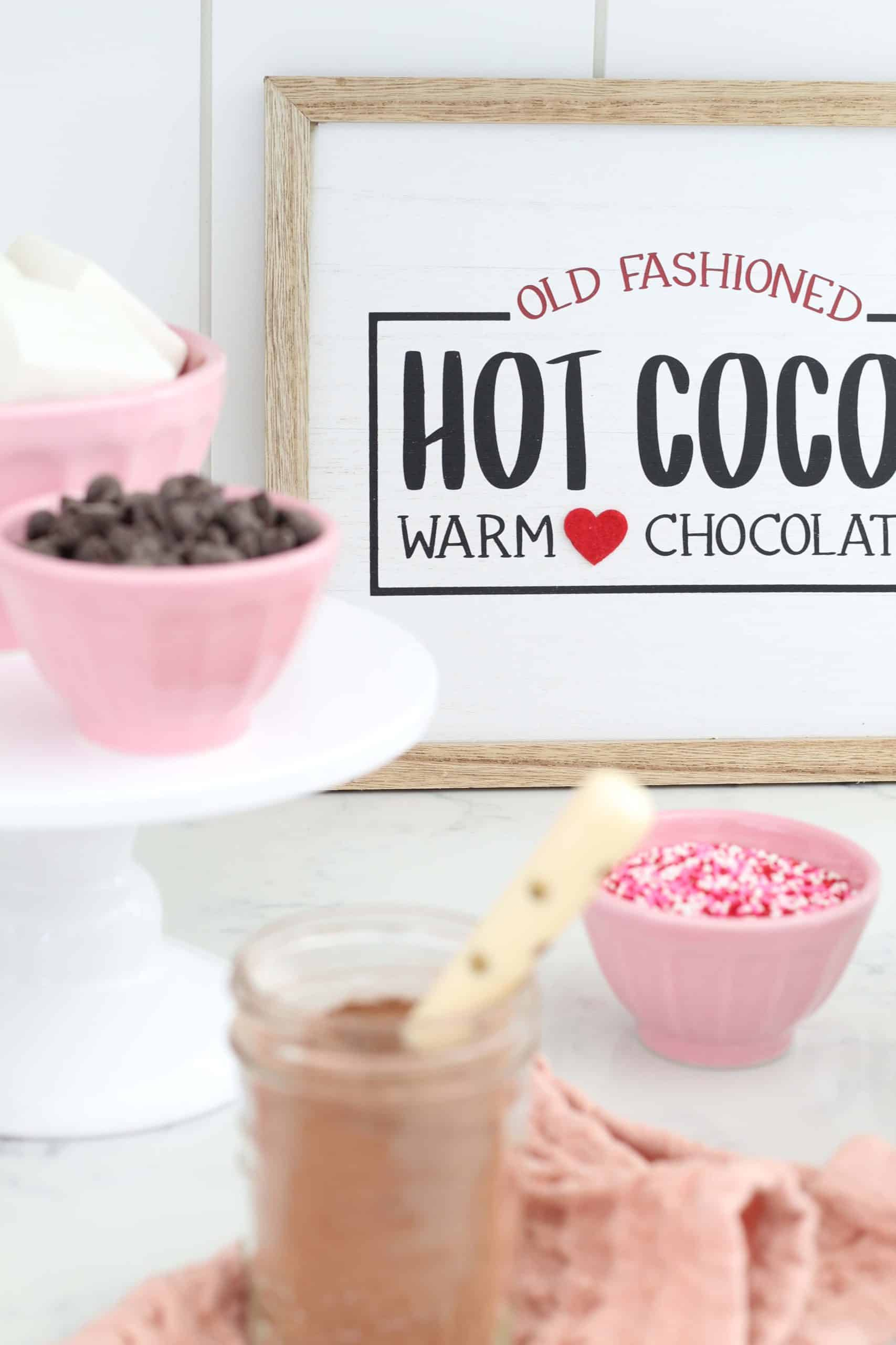 hot cocoa bar sign, pink anthropologie bowls, white cake stand