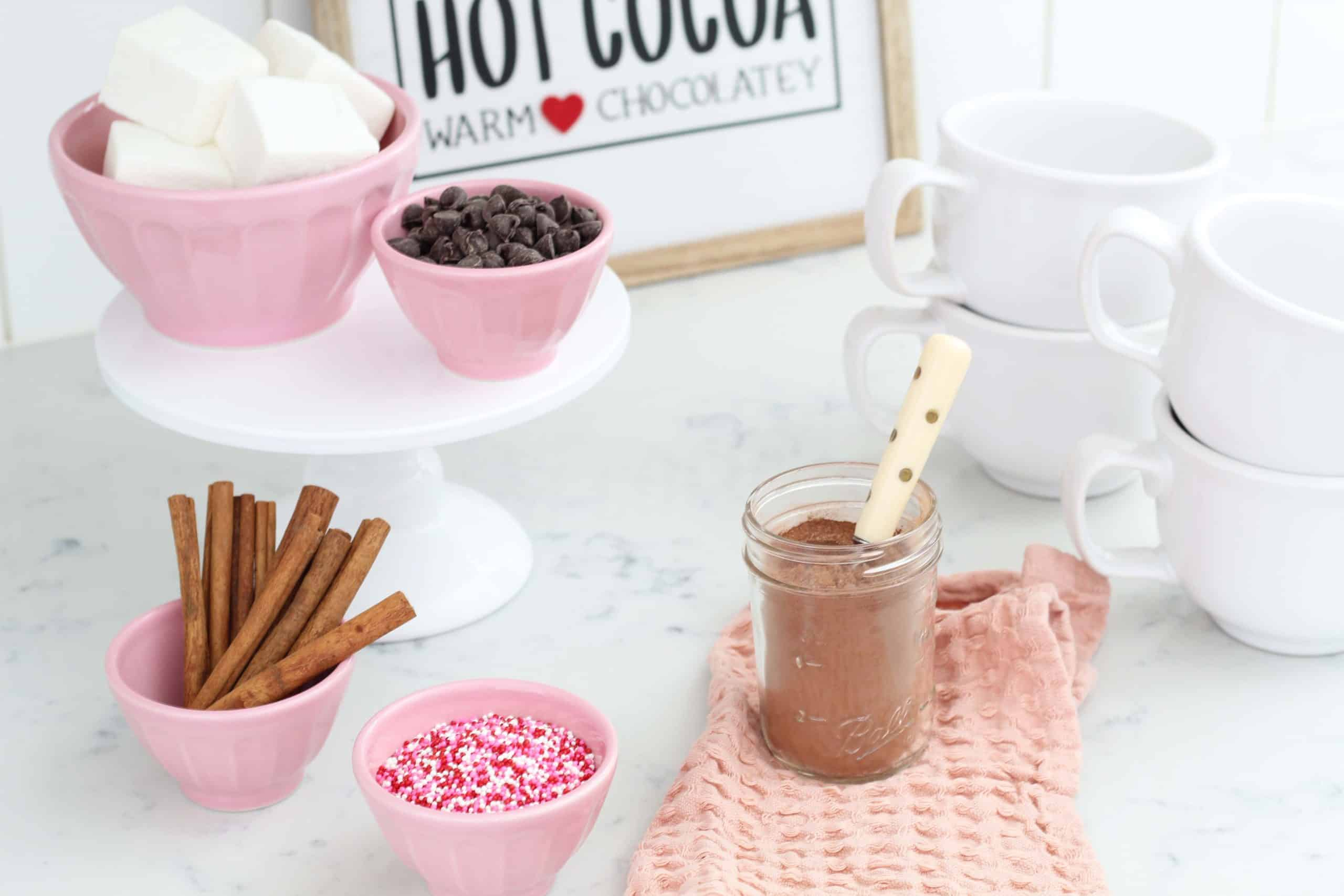 pink anthropologie bowls, white cake stand, homemade marshmallows, valentine's hot cocoa bar