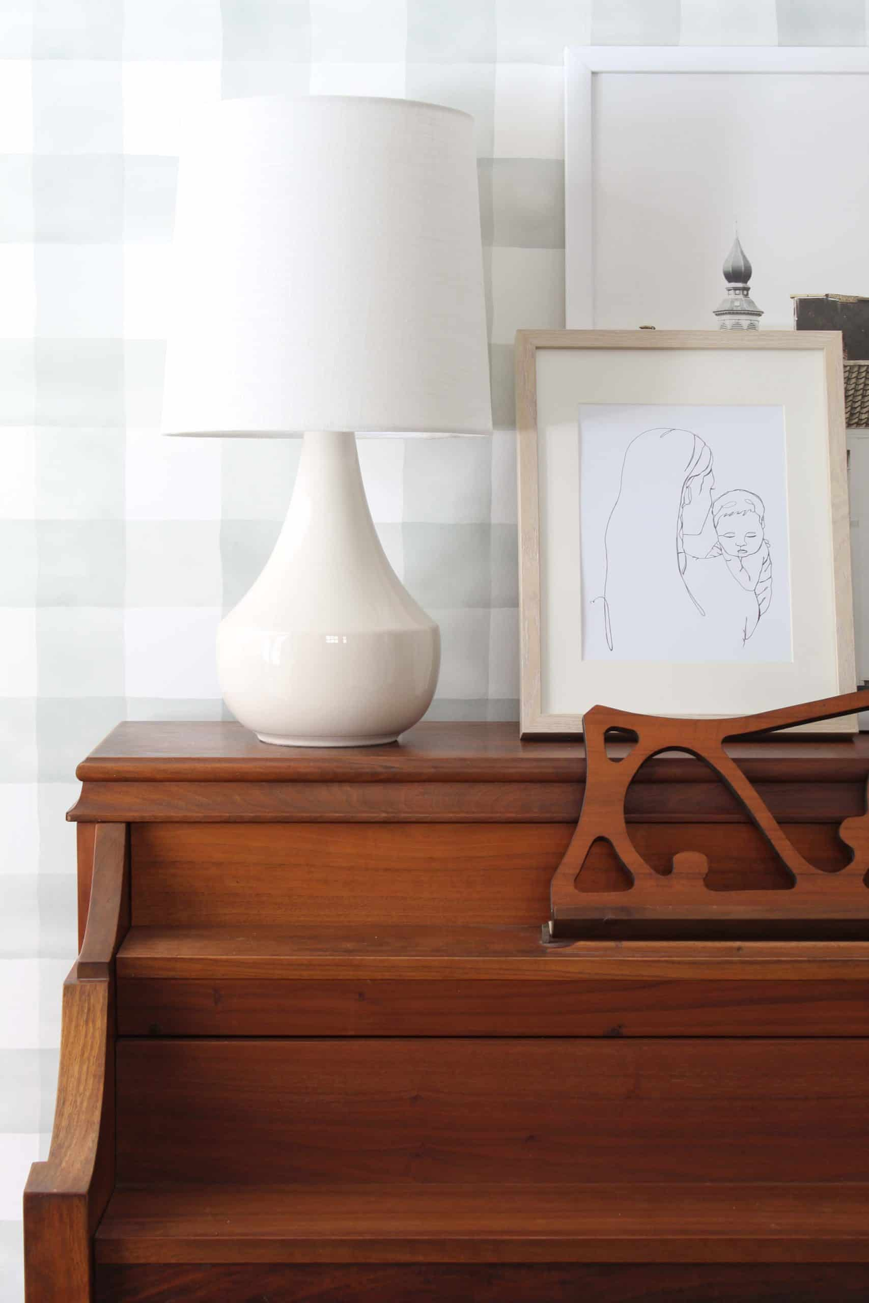 entryway with magnolia watercolor check wallpaper, vintage piano, and threshold wren lamp