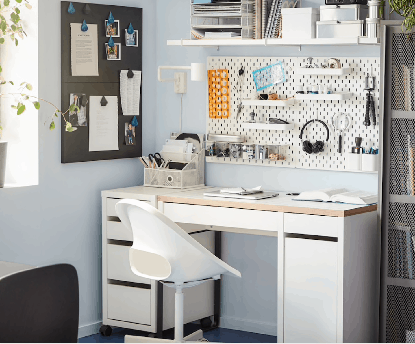 home office with pegboard above desk