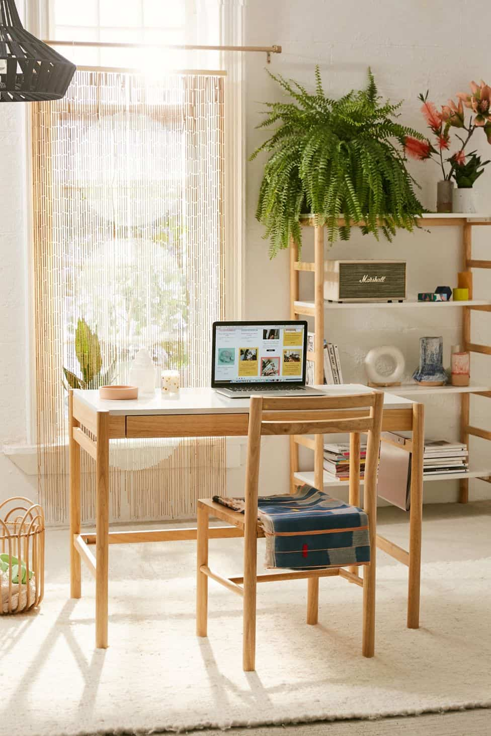 urban outfitters desk with large fern and marshall radio