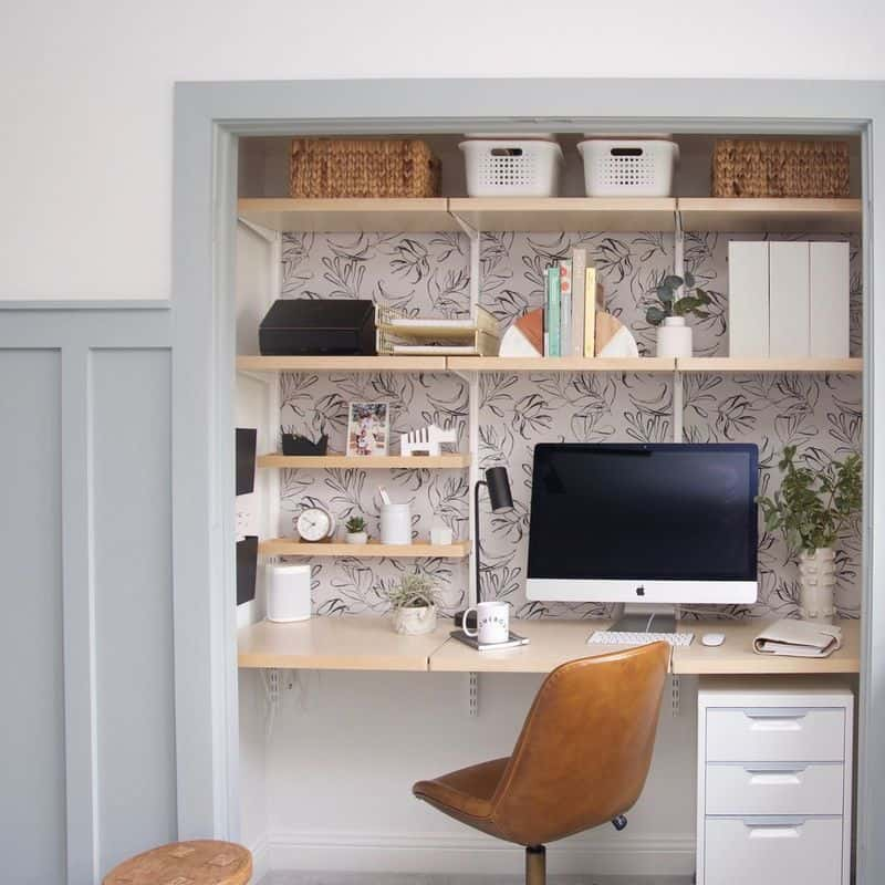 small home office in closet with floral wallpaper