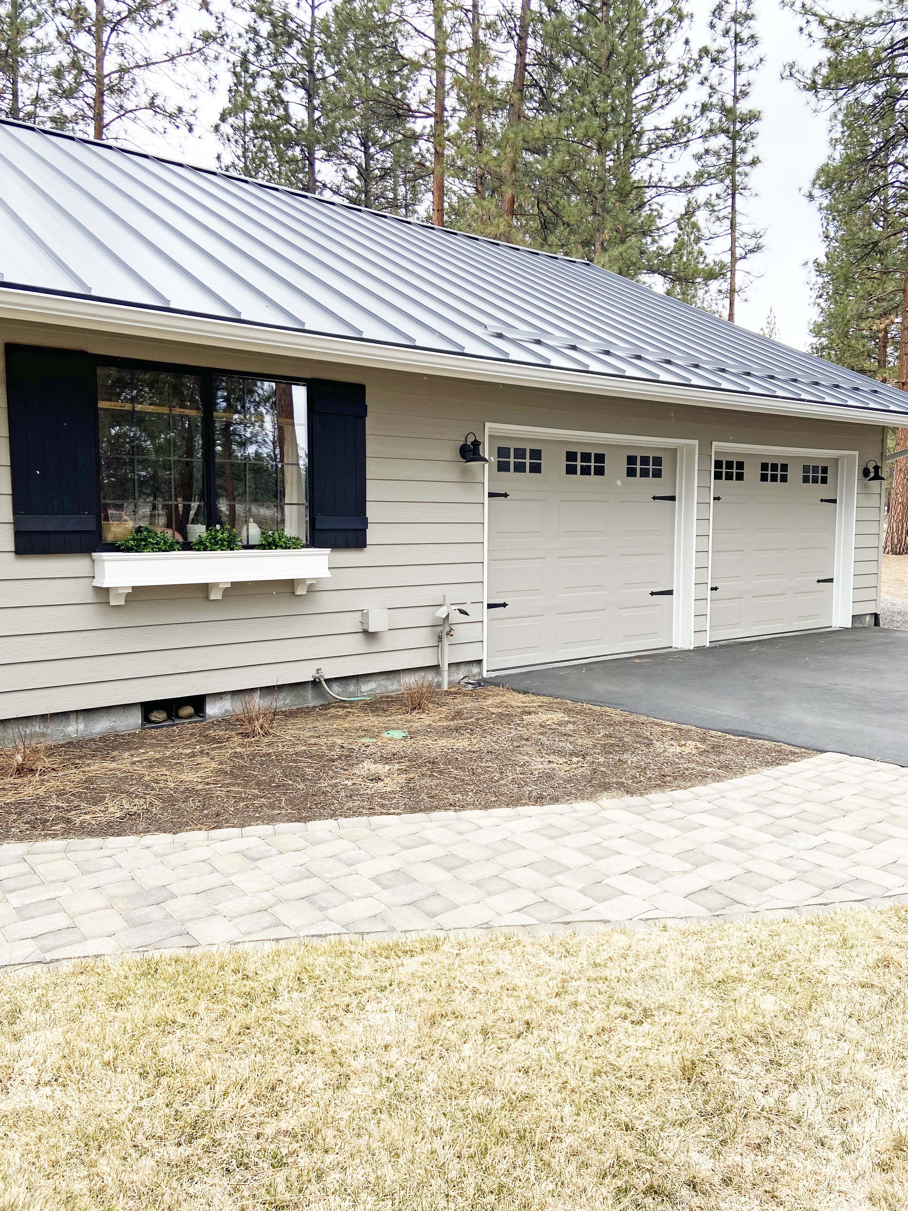 gray house with gray standing seam roof