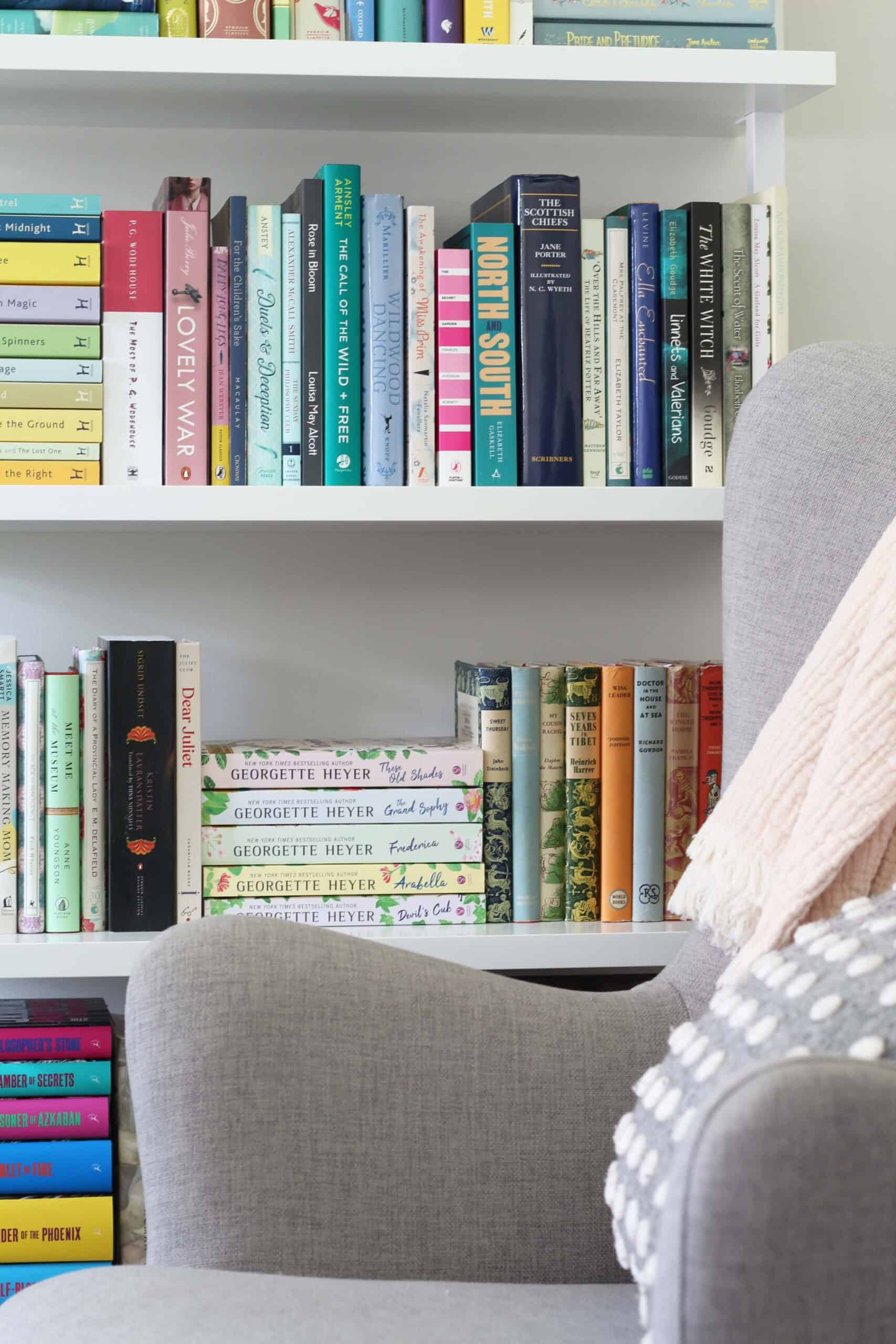 gray chair and ladder bookshelf with polka dot pillow